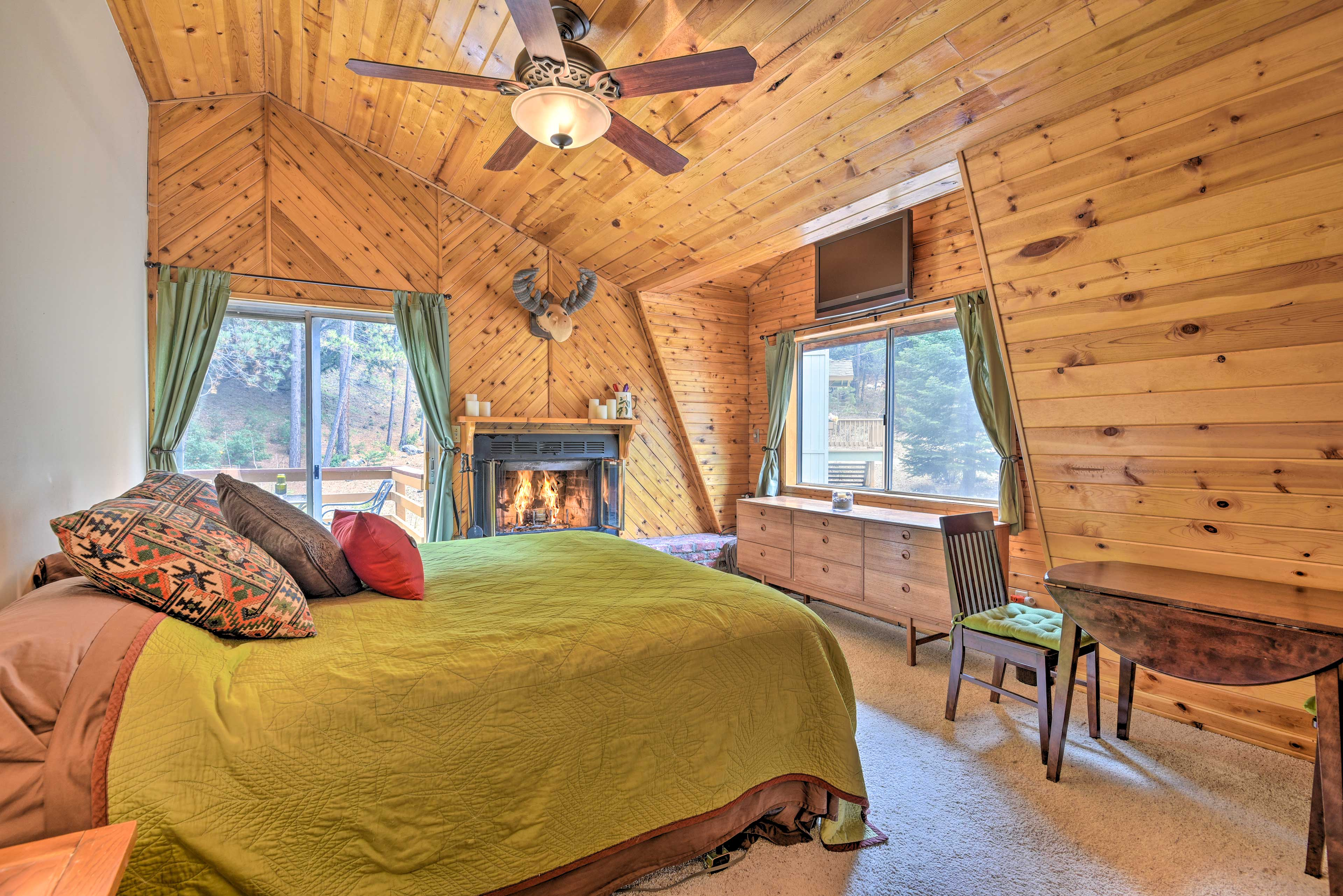 The master bedroom features a queen bed, fireplace, and flat-screen cable TV.