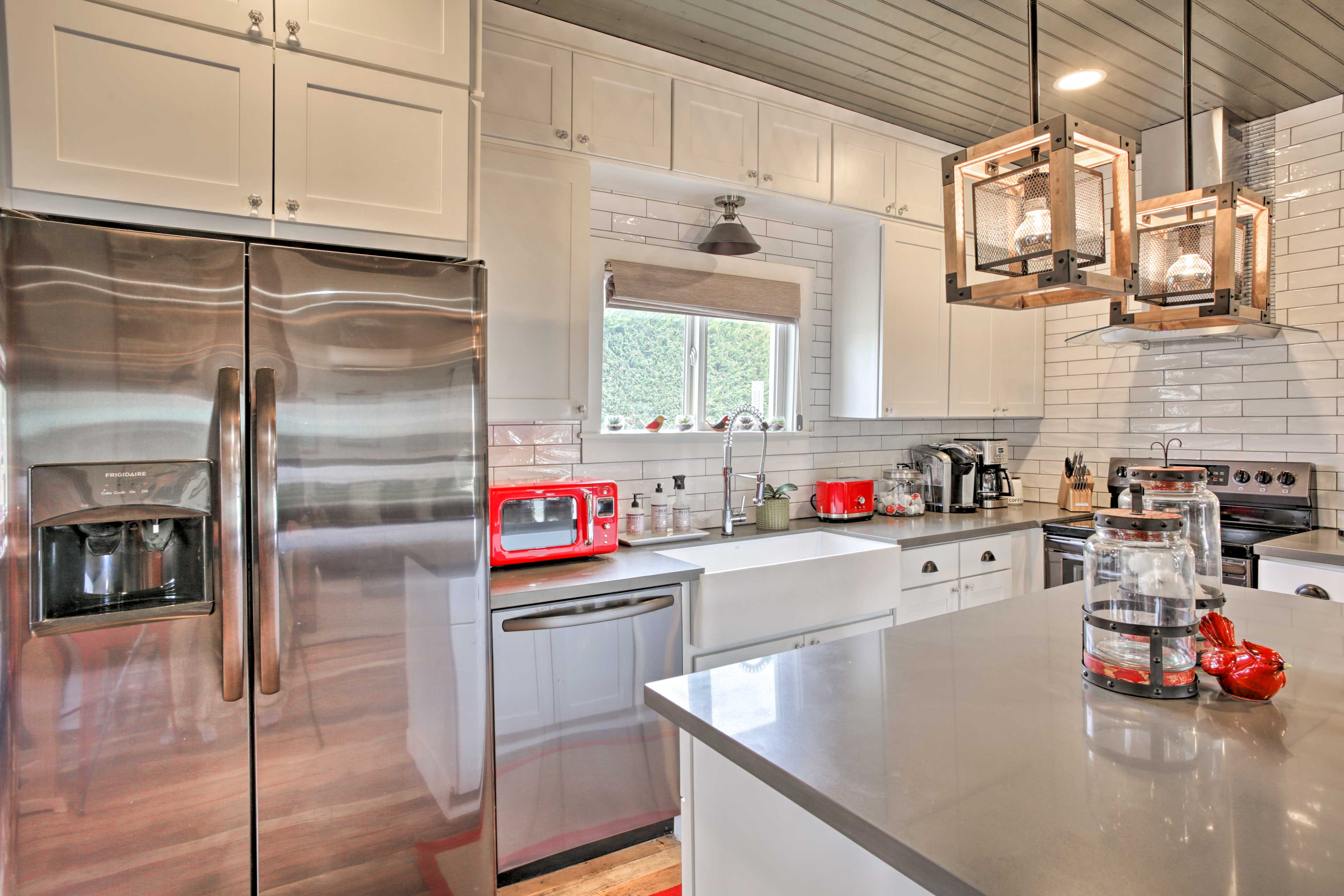 Red accents add vibrant touches of color to the stainless steel surroundings.