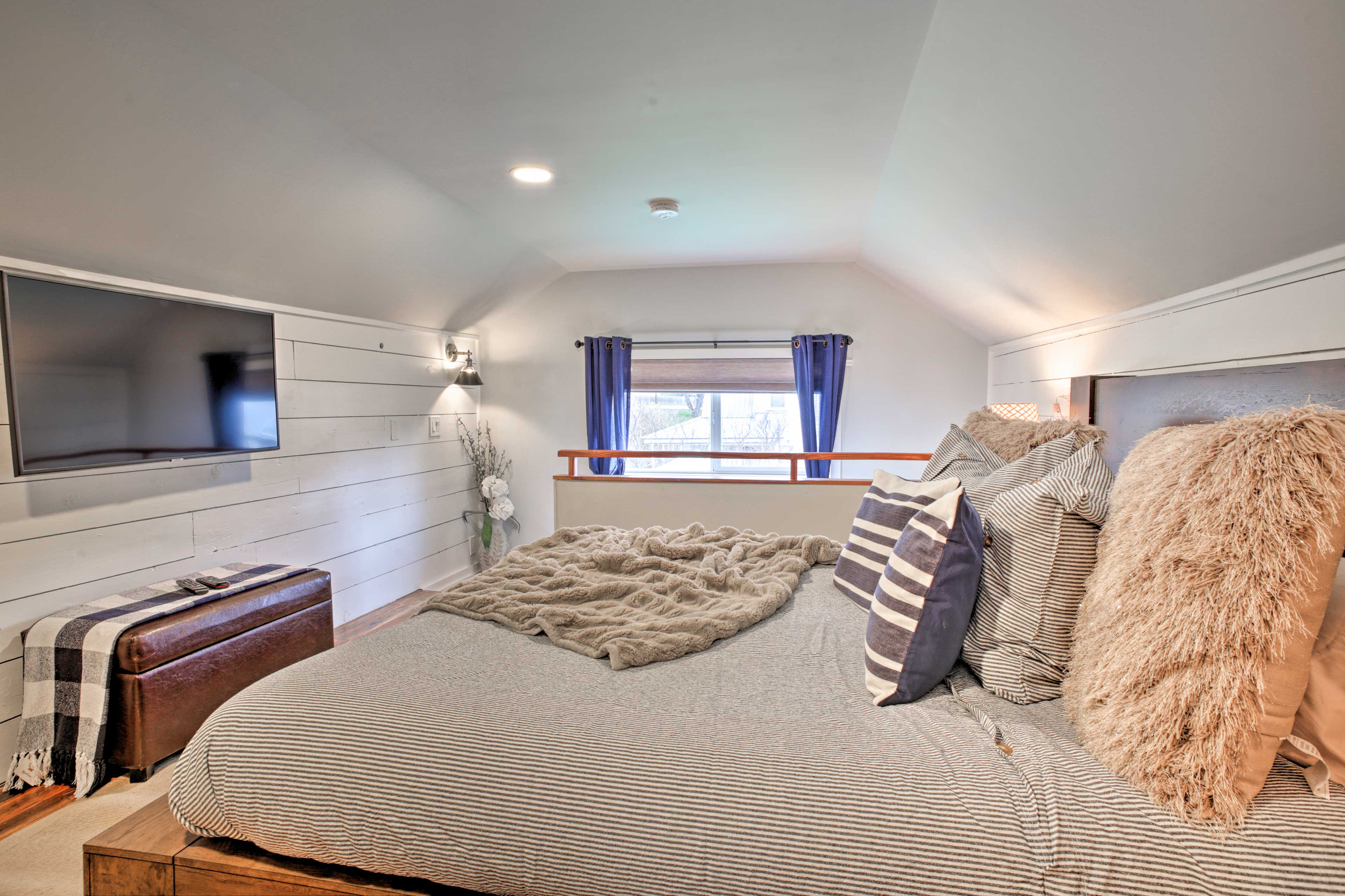 The airy master suite boasts a king bed and a flat-screen Smart TV!