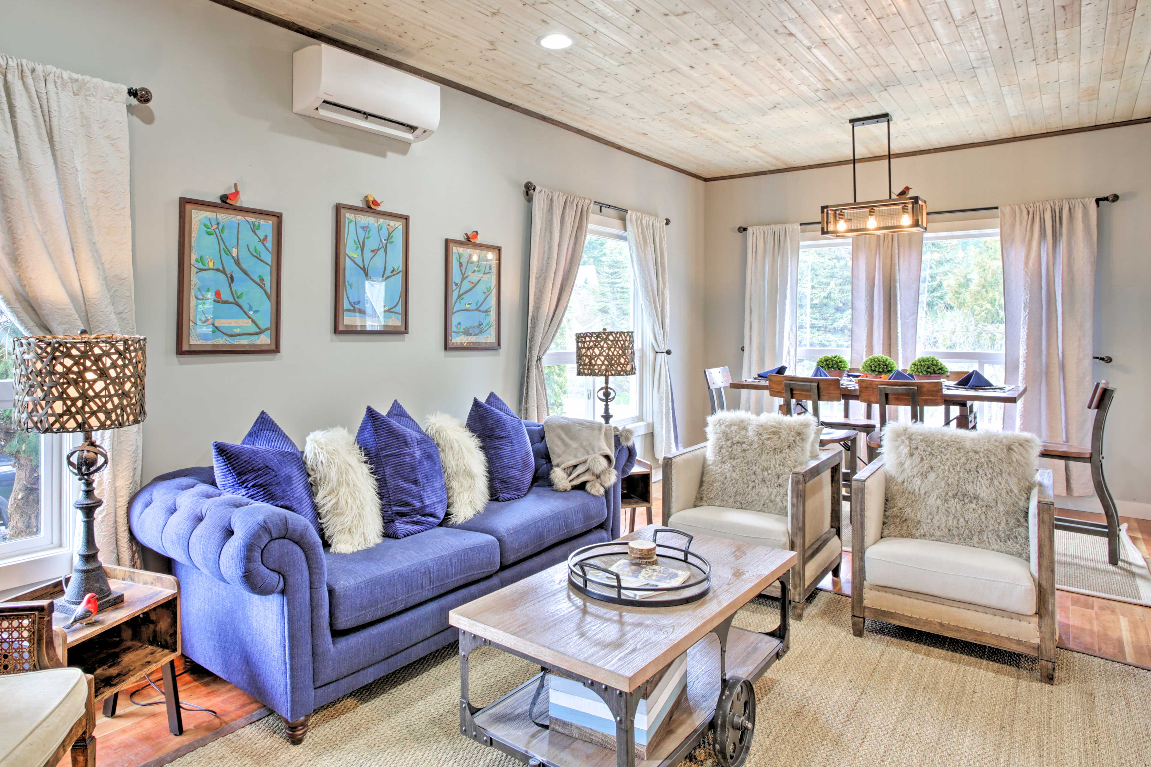 The 4-bedroom, 3-bathroom cottage boasts a stylish interior with sleek detail!