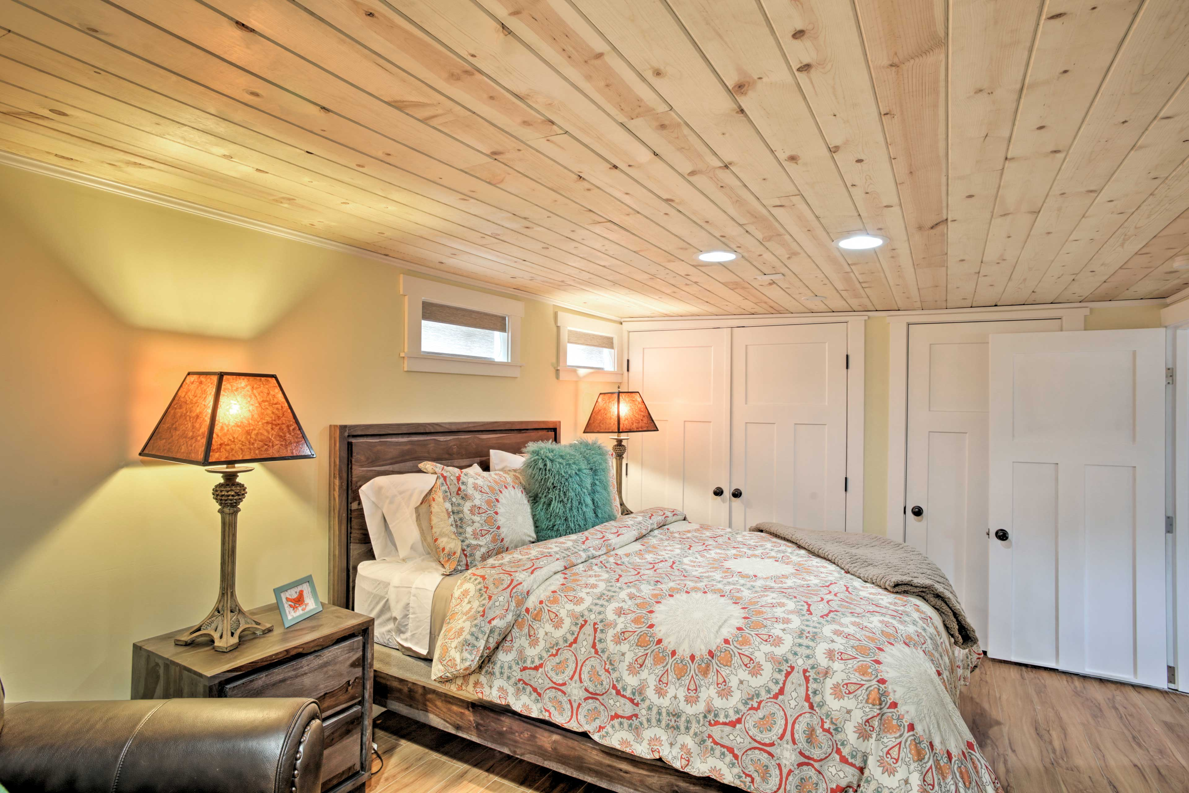 Double closets and a reading chair provide additional comforts.