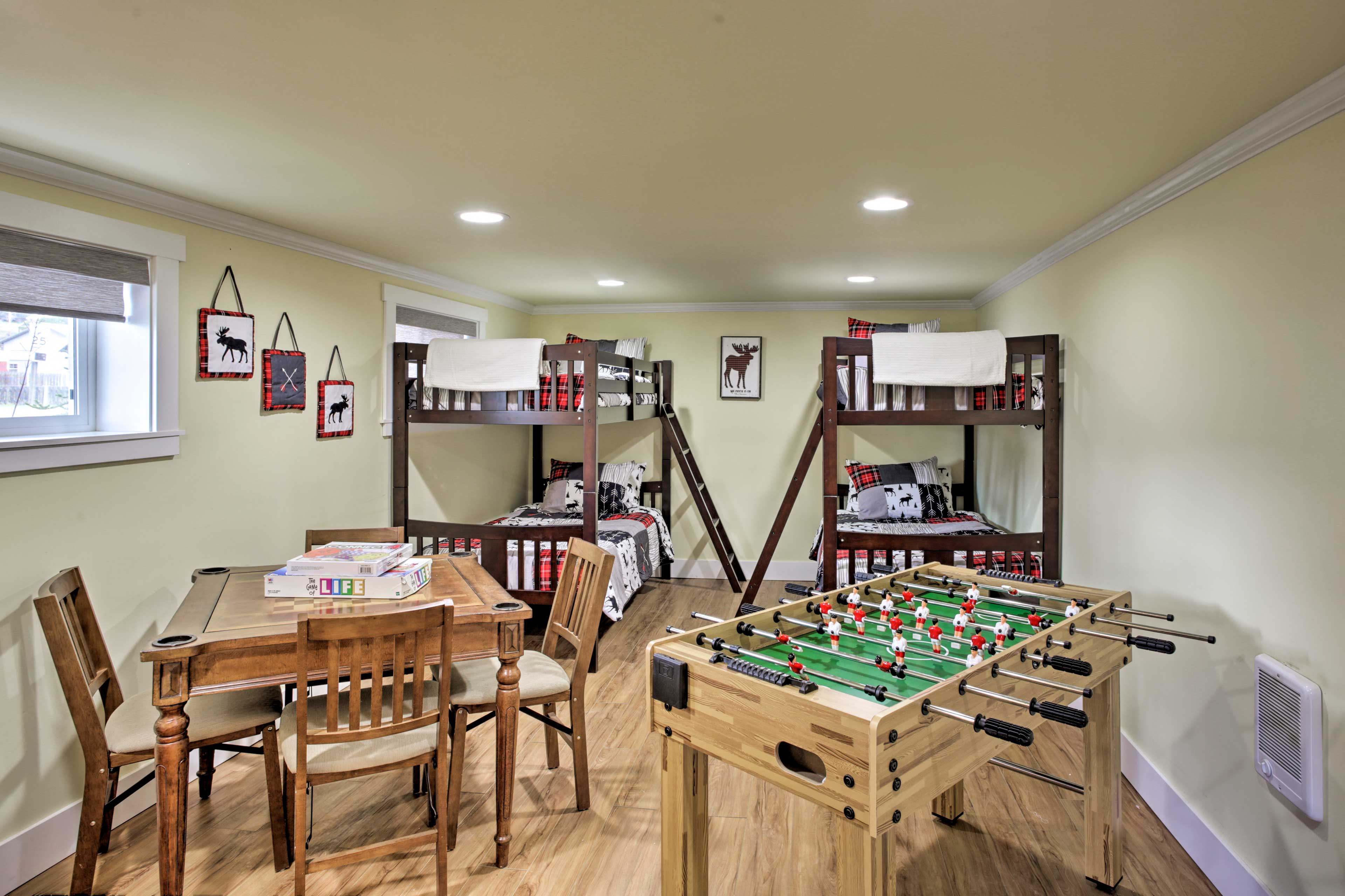 Downstairs, this second bedroom boasts both games and sleeping space!
