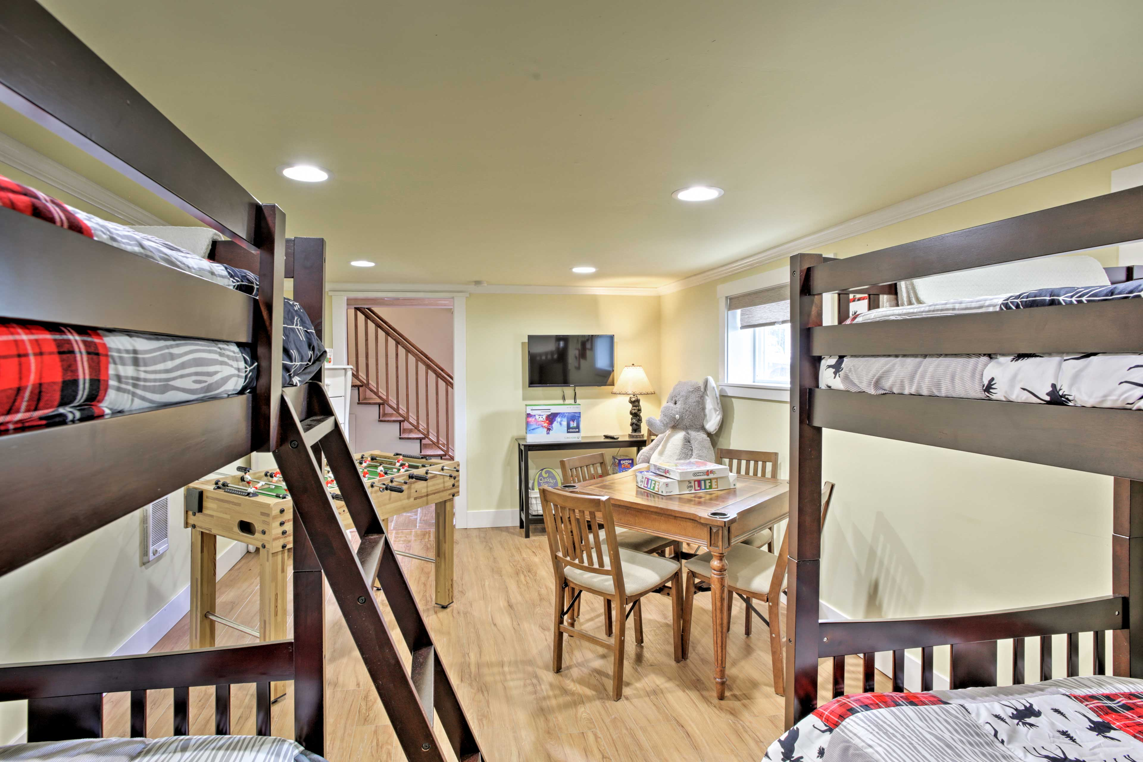 Two twin bunk beds, foosball and a flat-screen Smart TV complete the room.