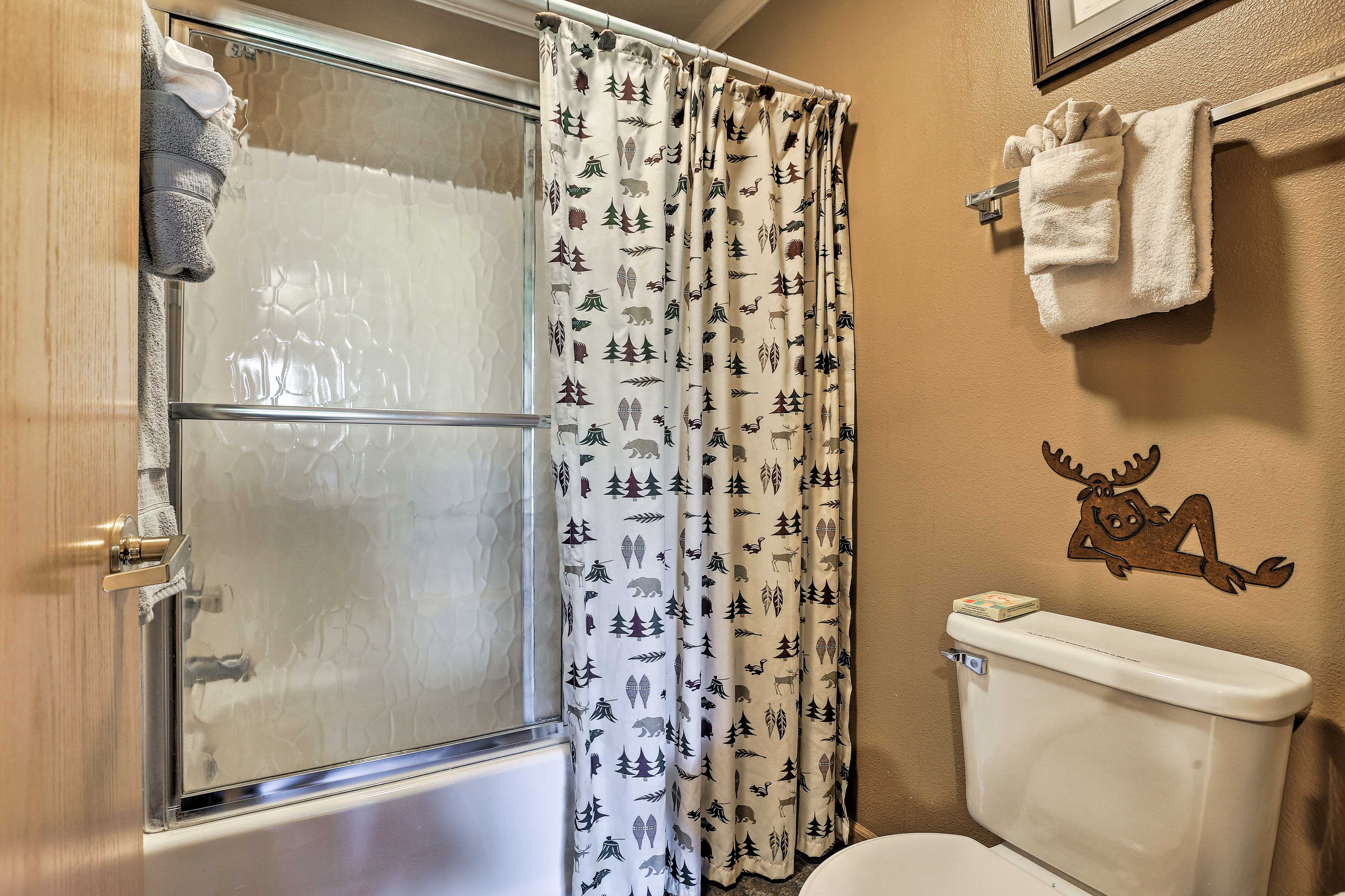 Rinse off the lingering lake water in the shower/tub combo.