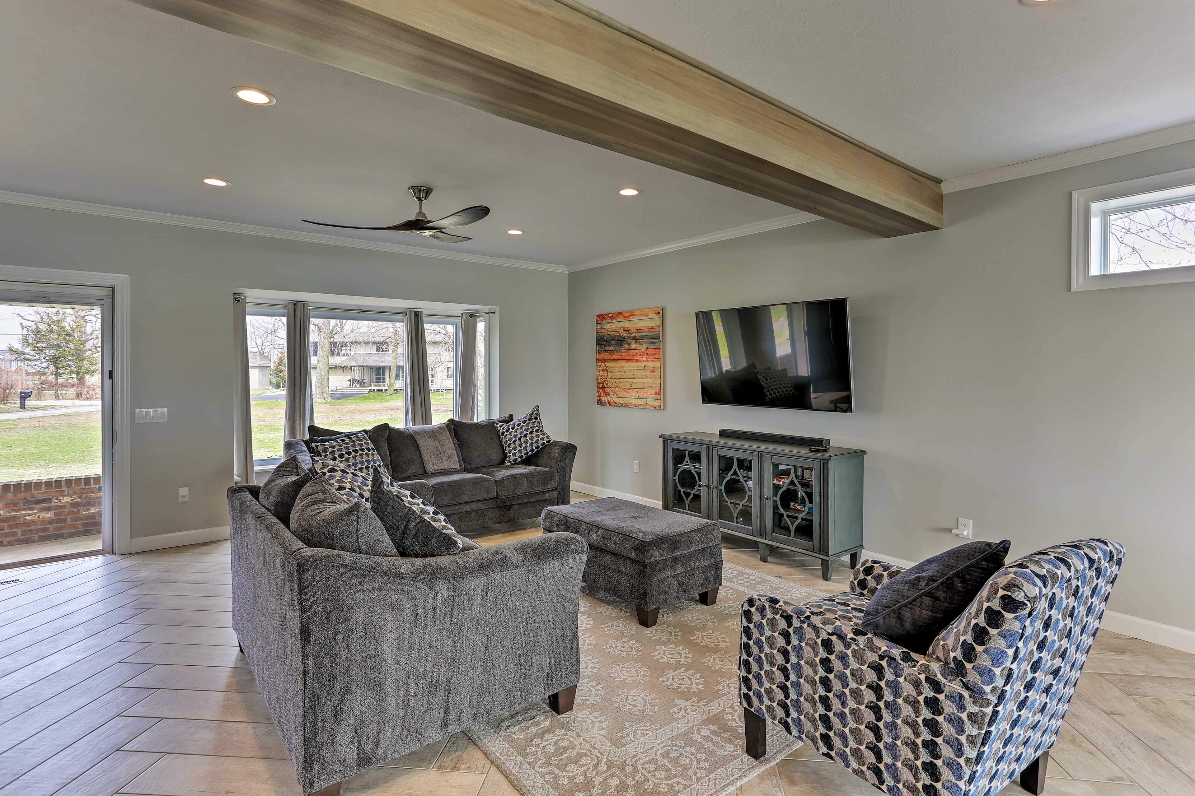 Sink into the plush furniture and watch shows on the flat-screen cable Smart TV.