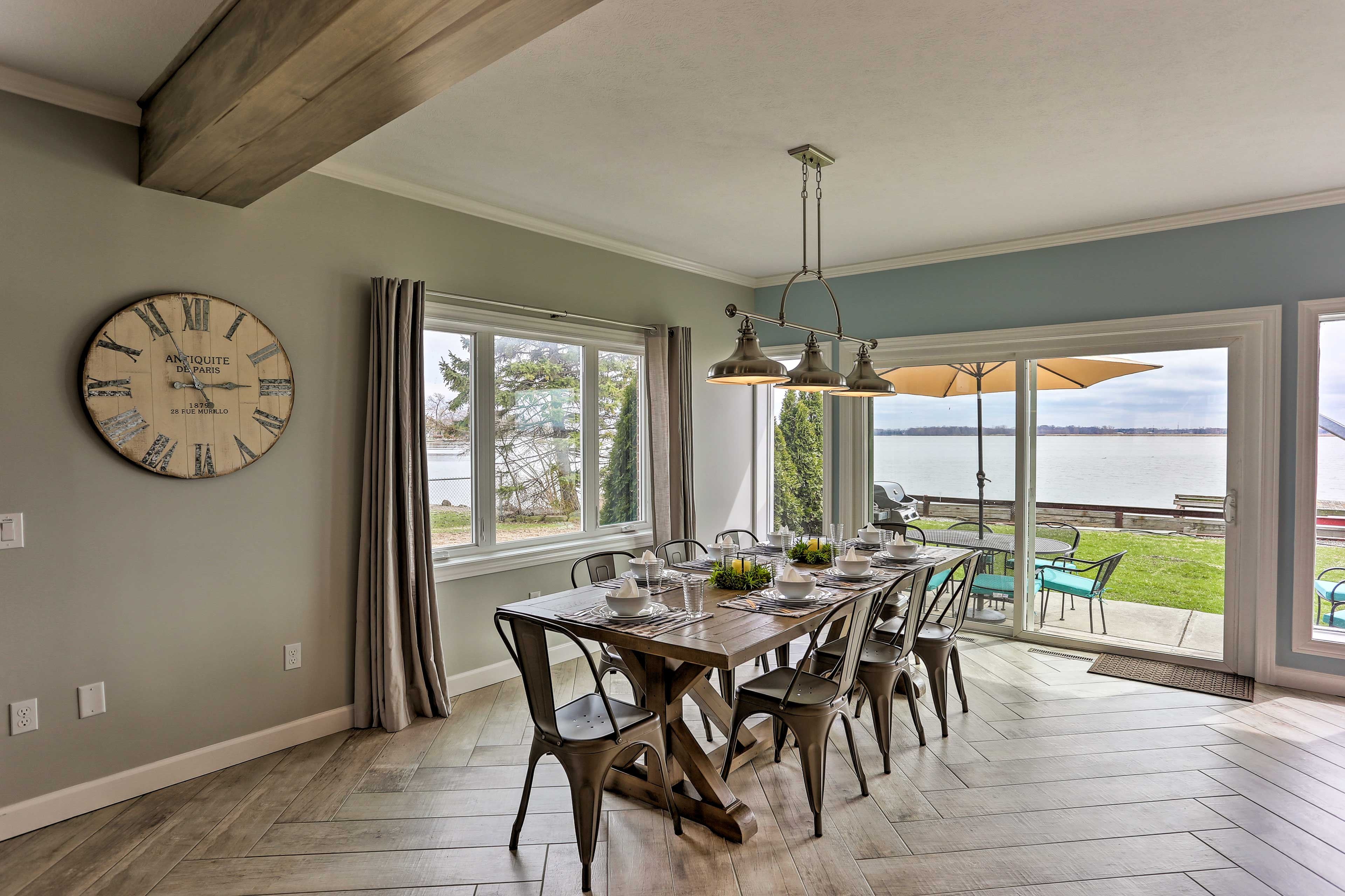 Gather at the 8-person dining table to savor home-cooked meals.