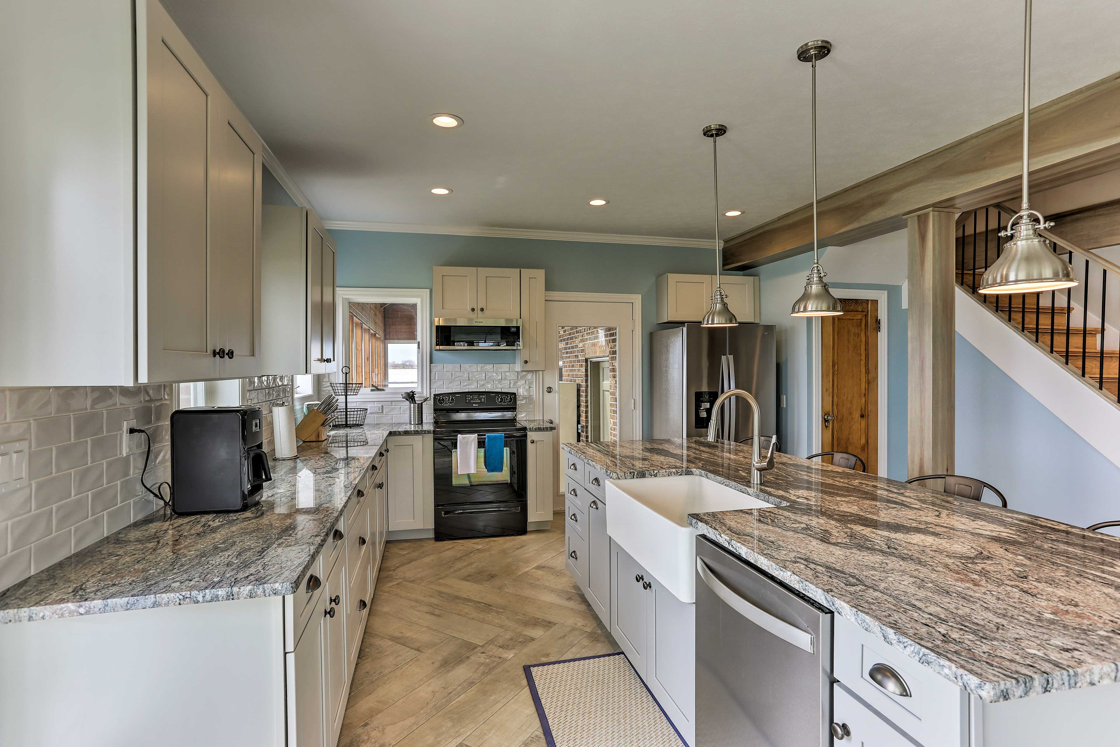The kitchen comes fully equipped for your cooking endeavors.