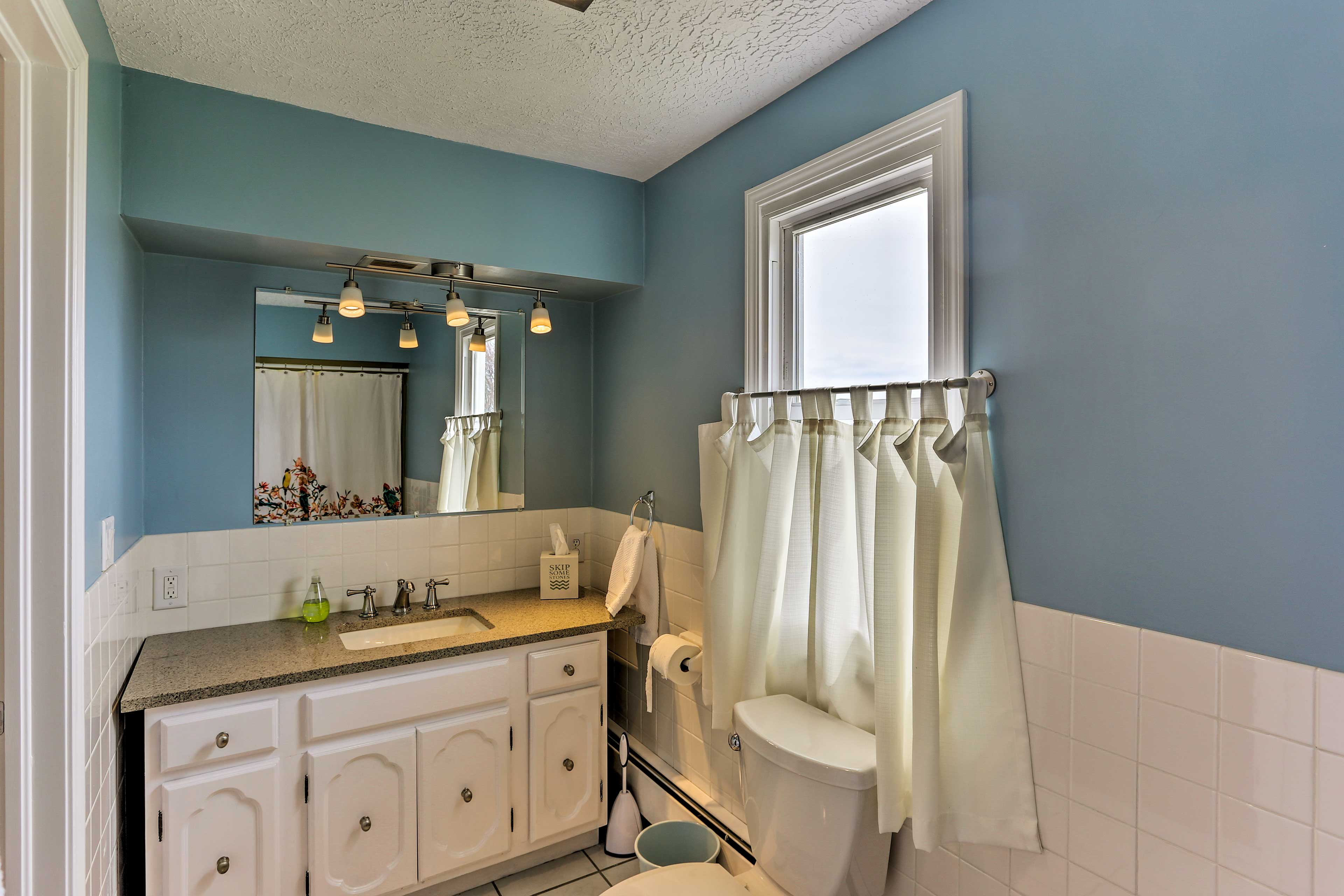 Use the large counter space to spread out your toiletries and get ready.