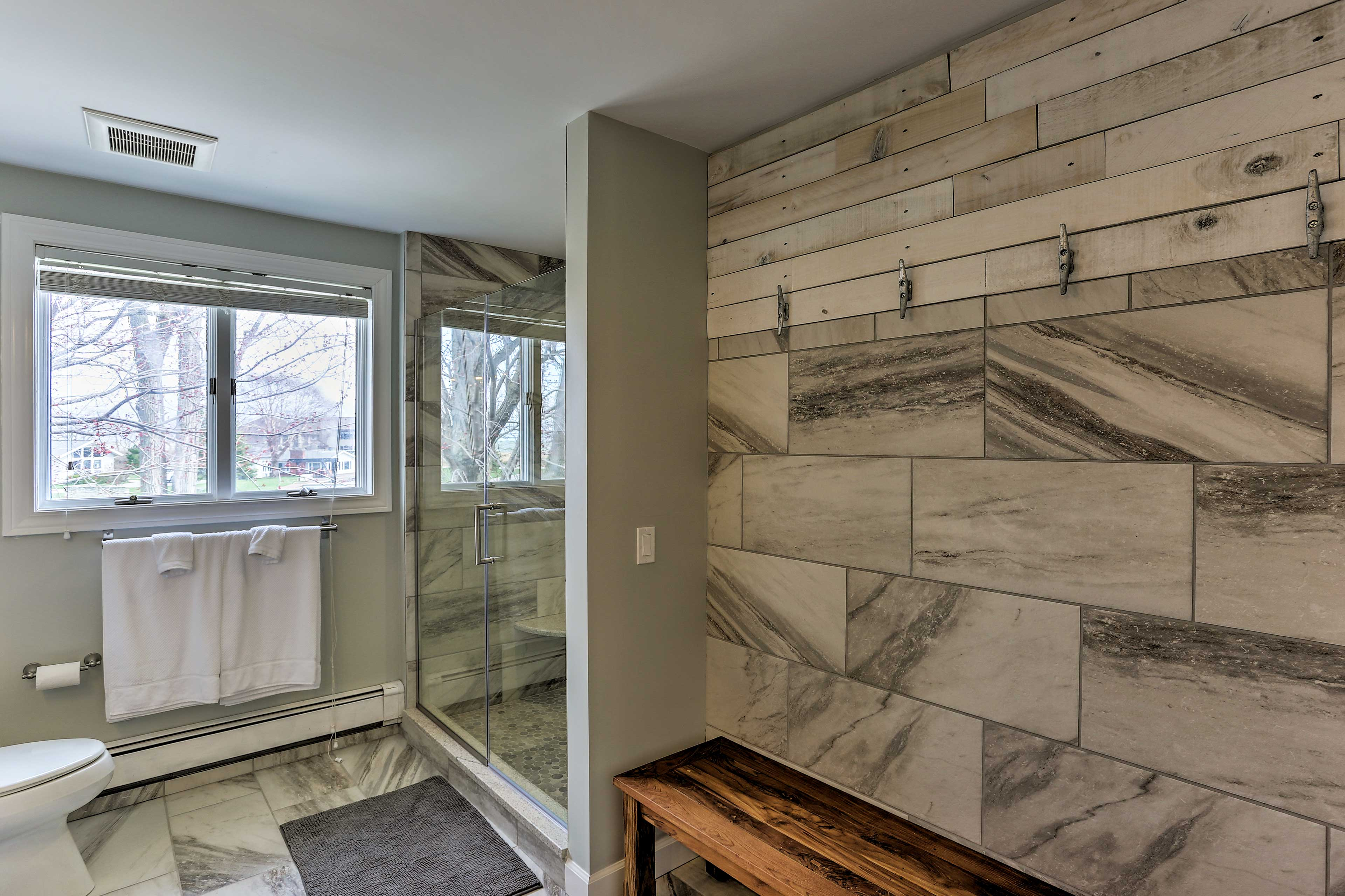 Step into the large walk-in shower to rinse off the day.
