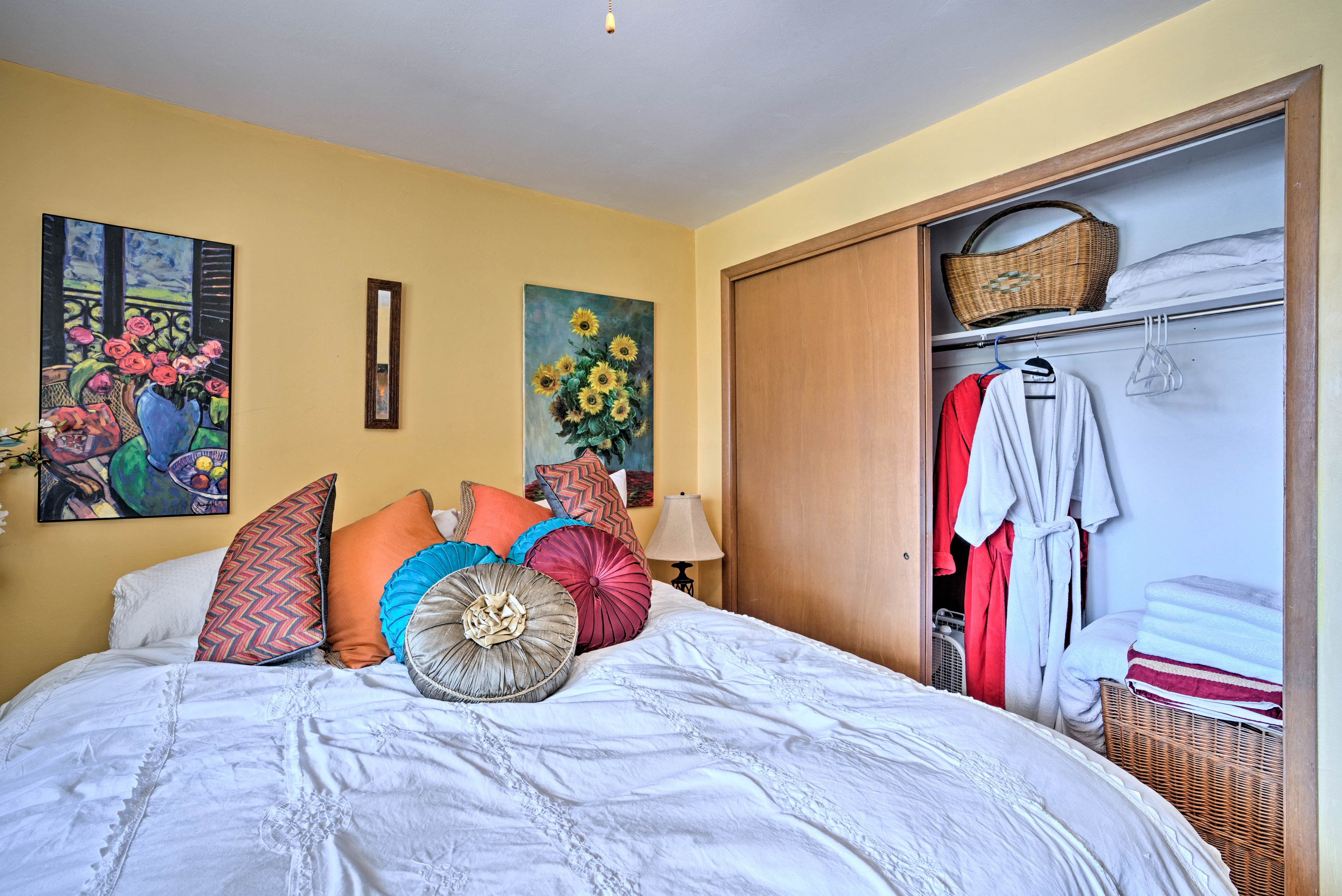 A queen bed highlights this bright bedroom.
