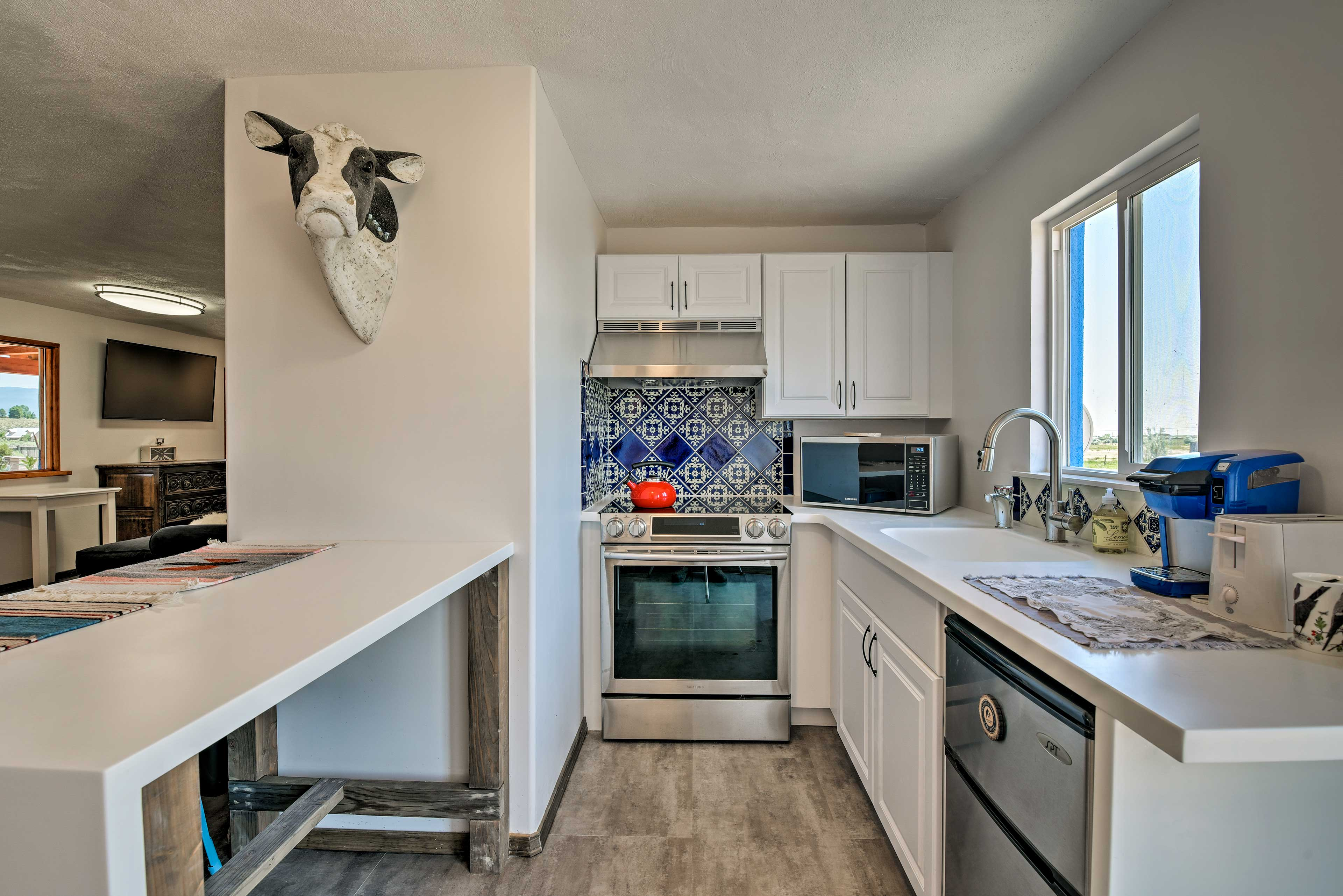 The custom tiling gives the kitchen a unique southwestern feel.
