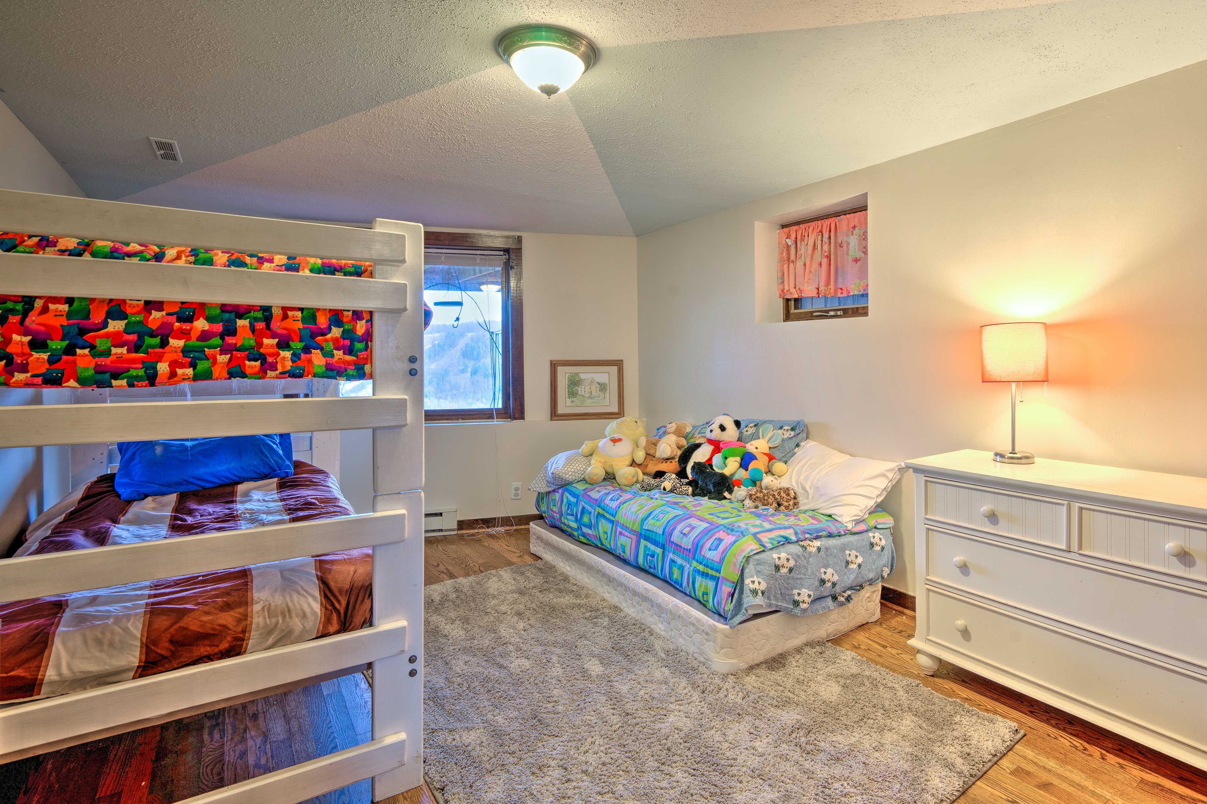 The second room features a twin over twin bunk bed and an additional twin bed.
