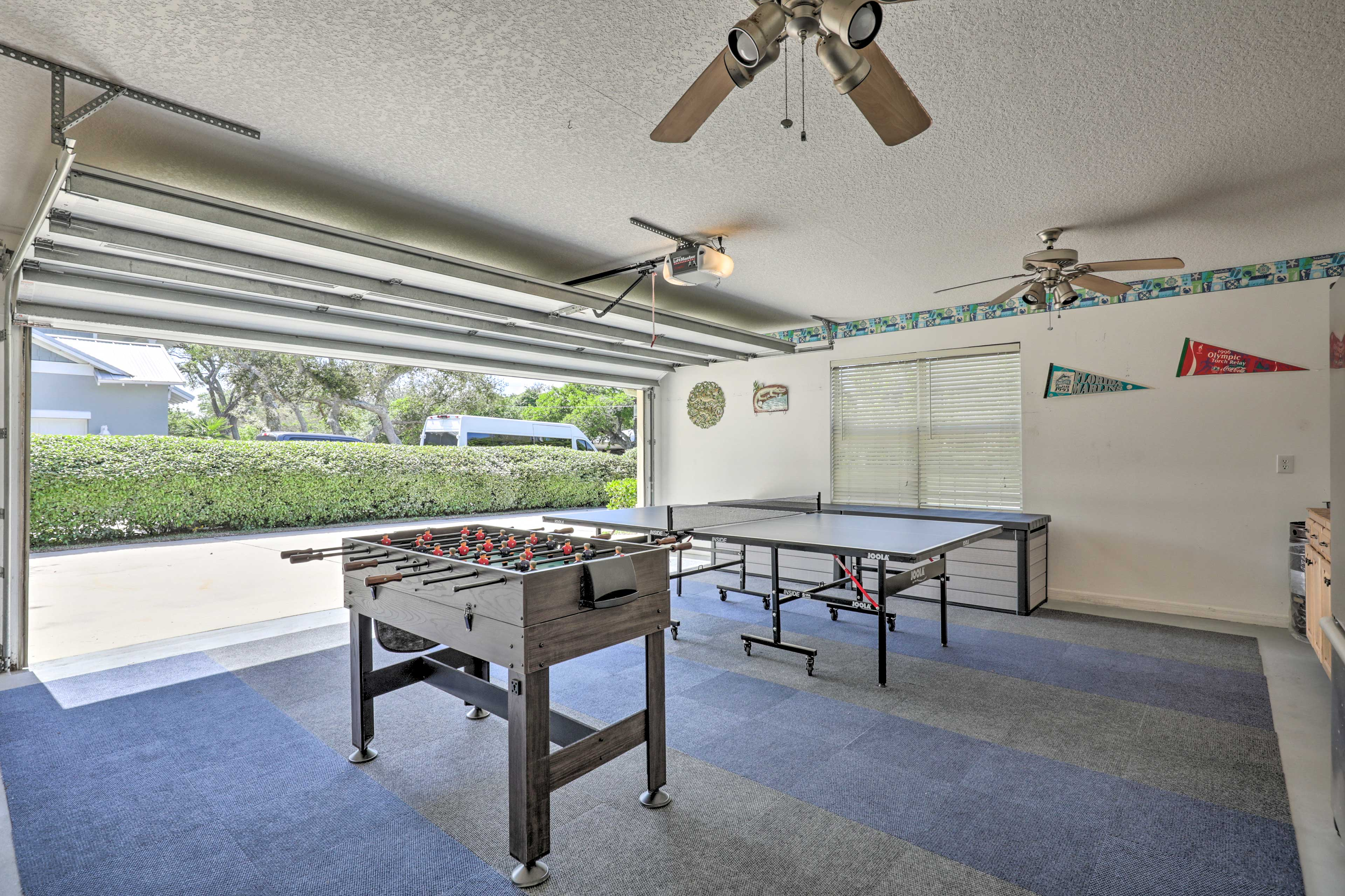 The garage has been converted to a game room with Foosball and ping pong.