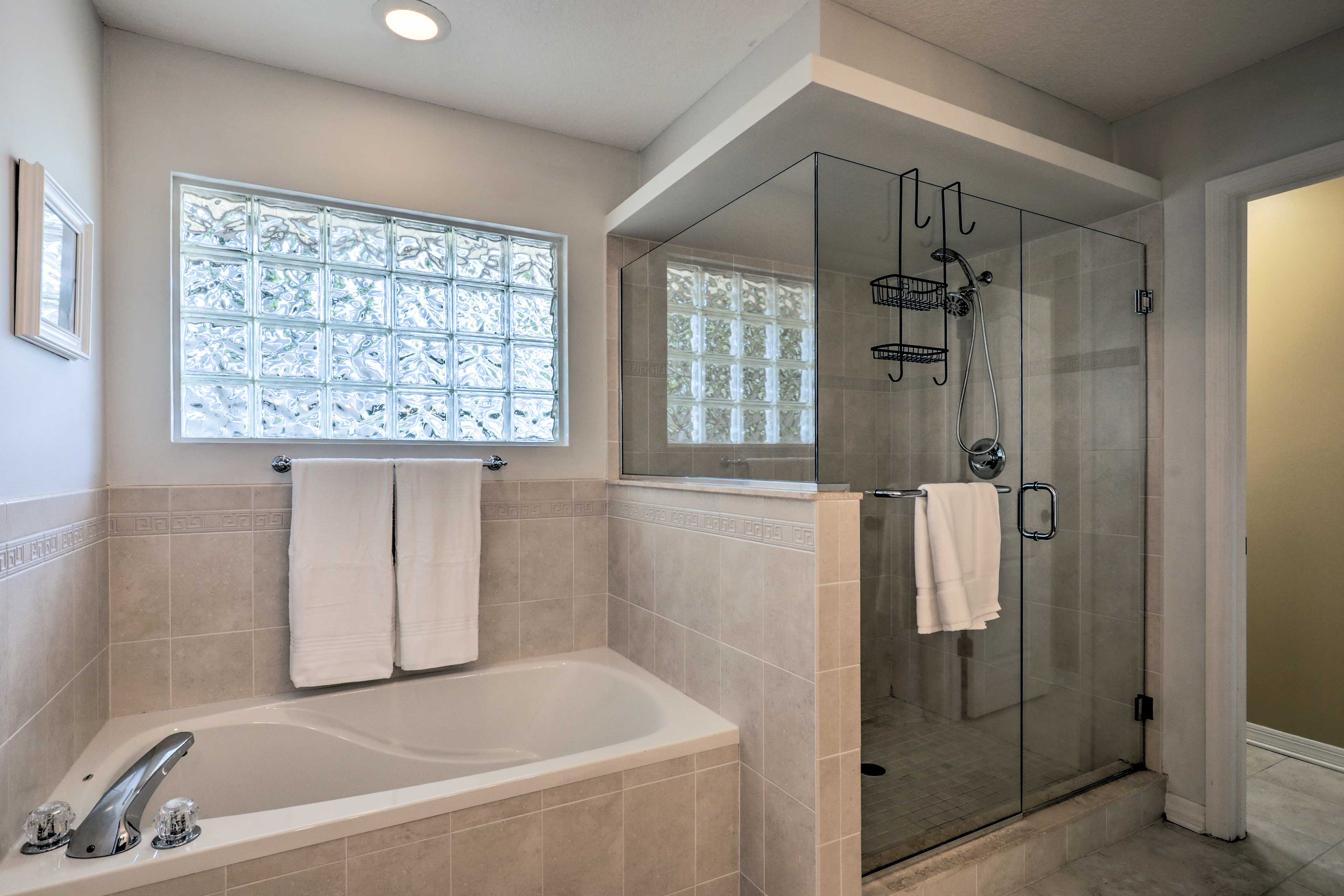 Rinse off in the walk-in shower or soak in the large bathtub.