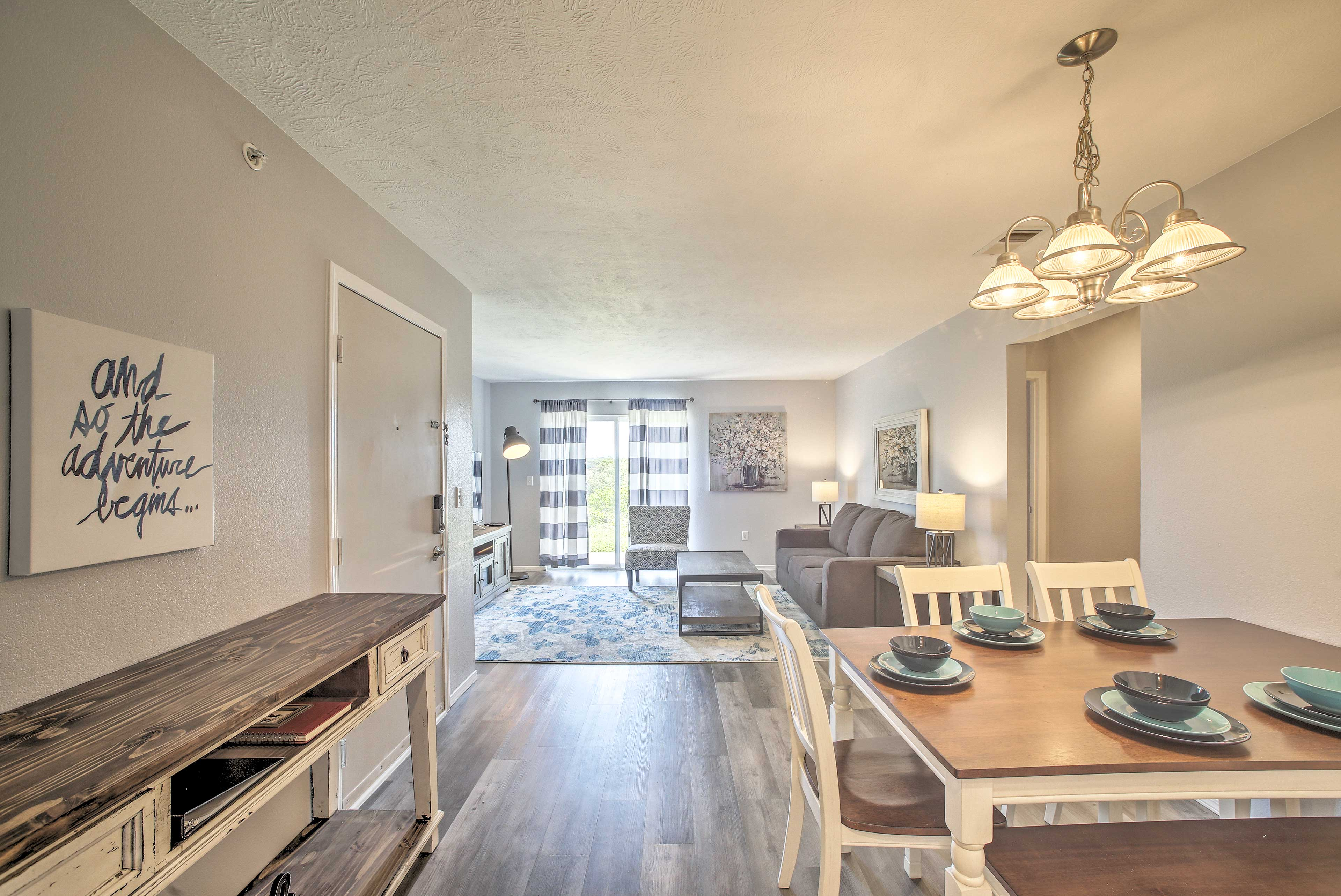 An open layout connects the kitchen, living and dining spaces.