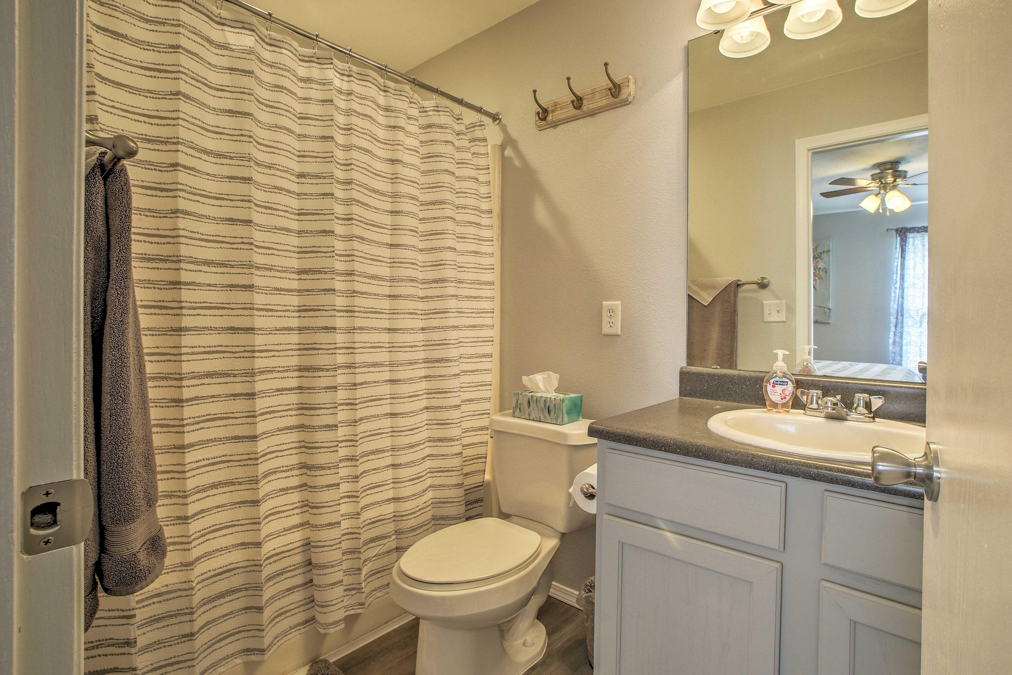 Freshen up in the master en-suite bathroom.