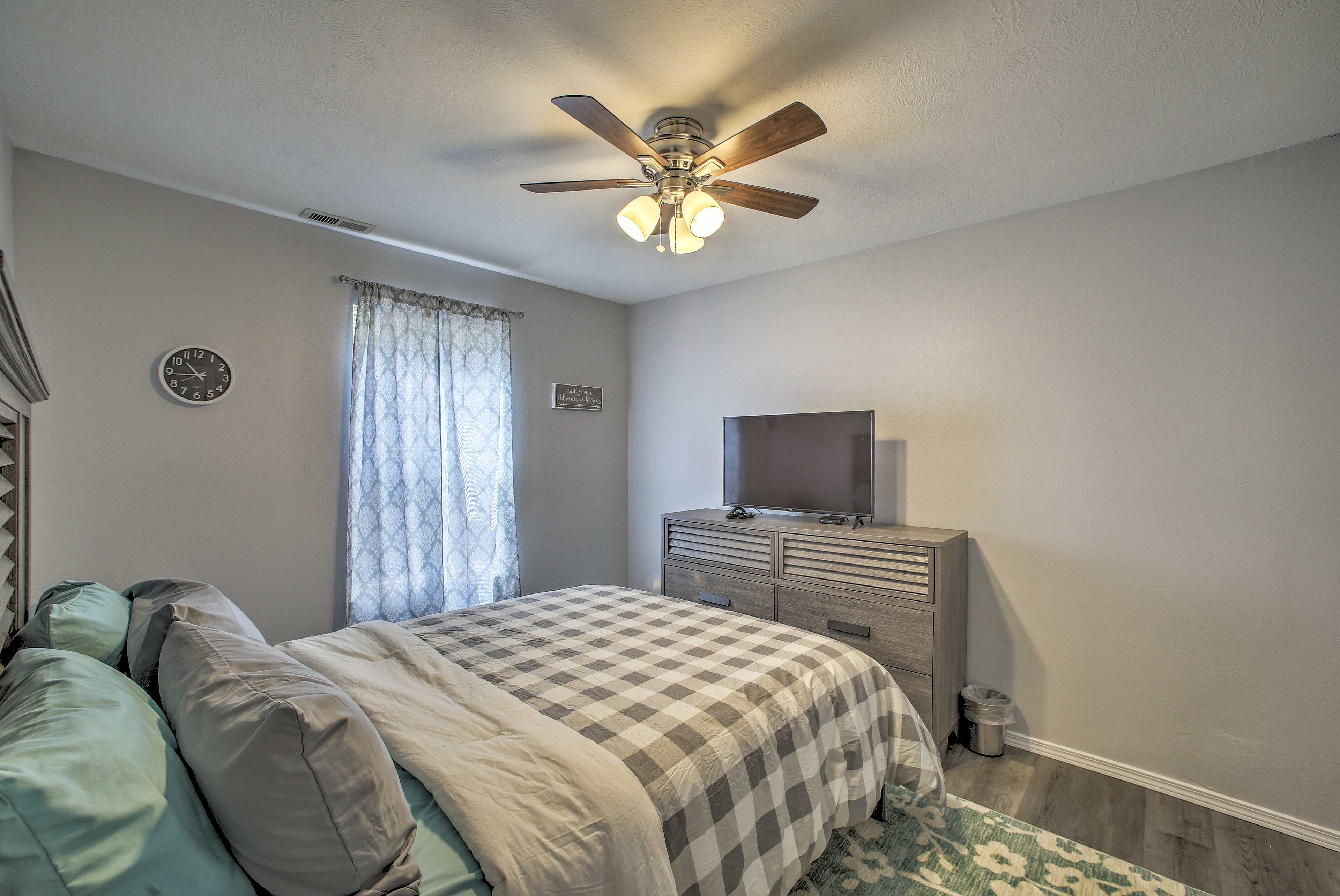 The second bedroom houses a queen bed and Smart TV.