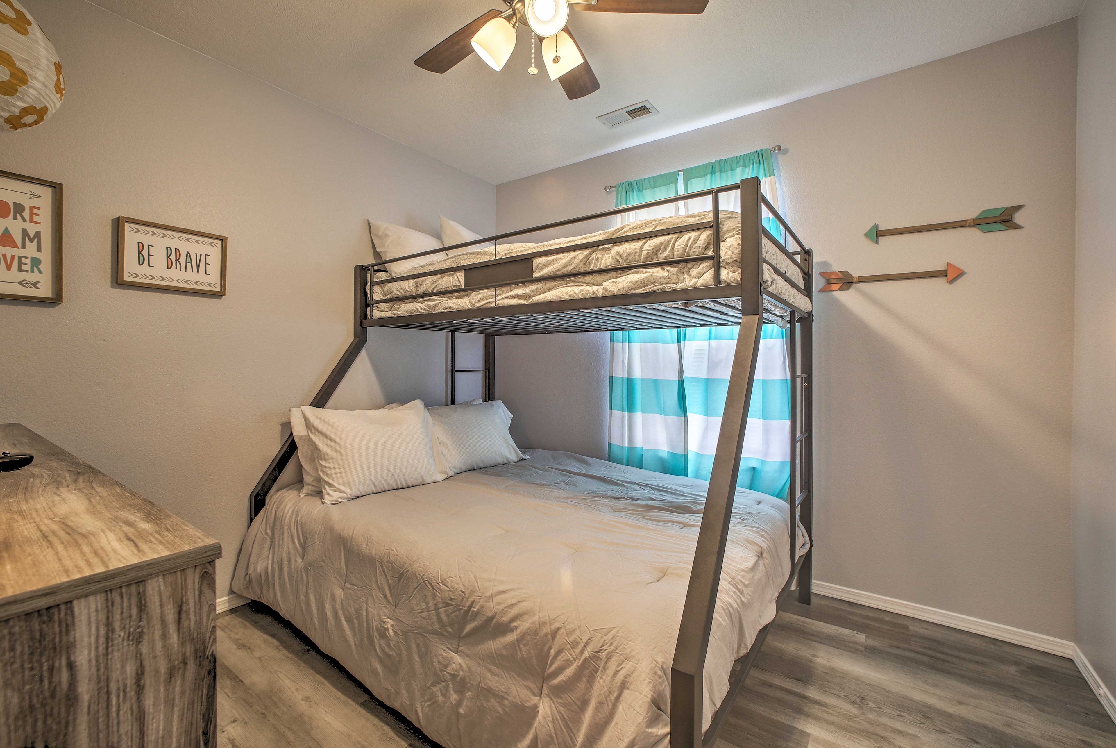 The third bedroom houses a twin-over-queen bunk bed.