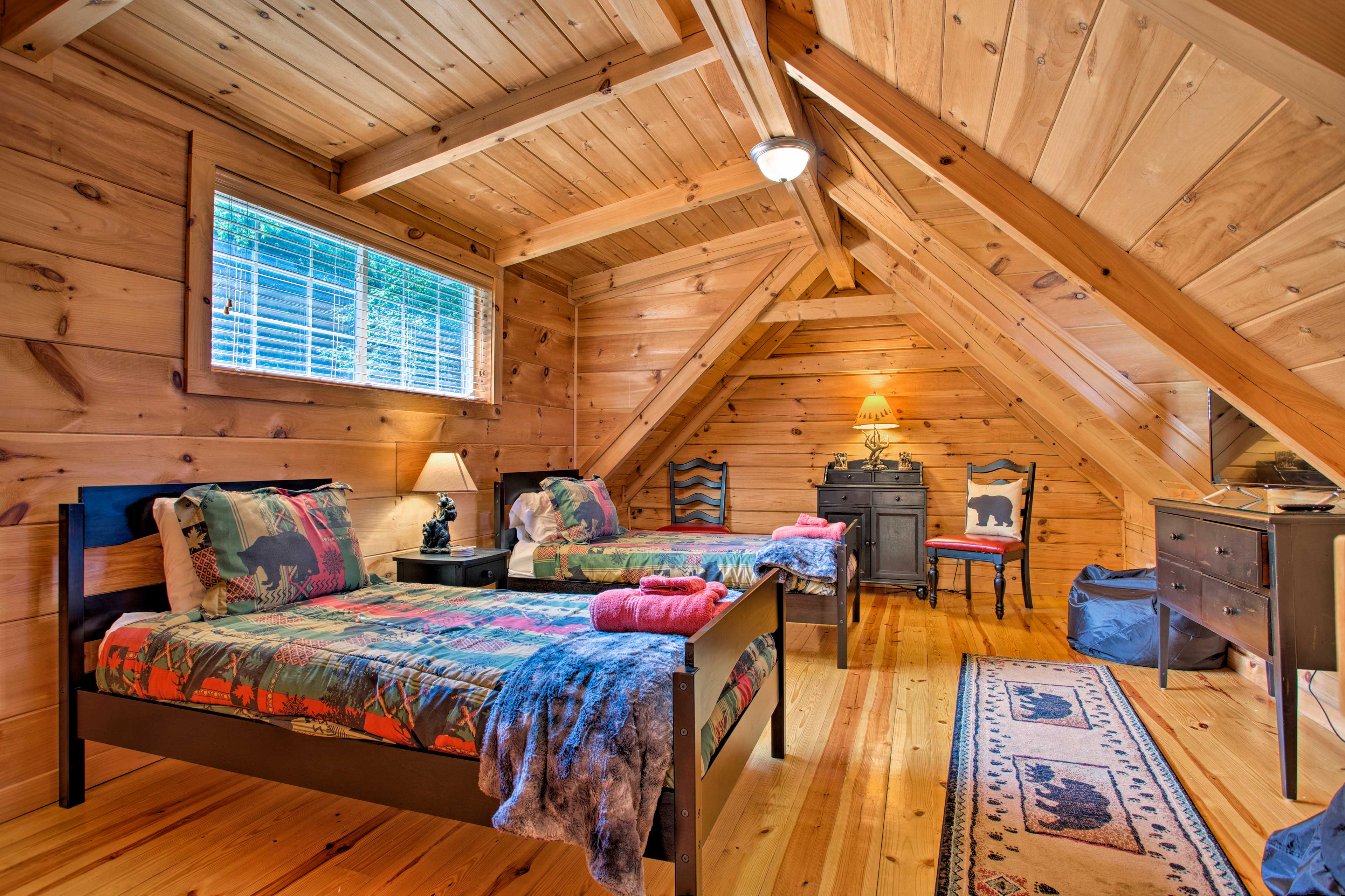 The kids can claim the loft with 2 twin beds, bean bag chairs & a TV.