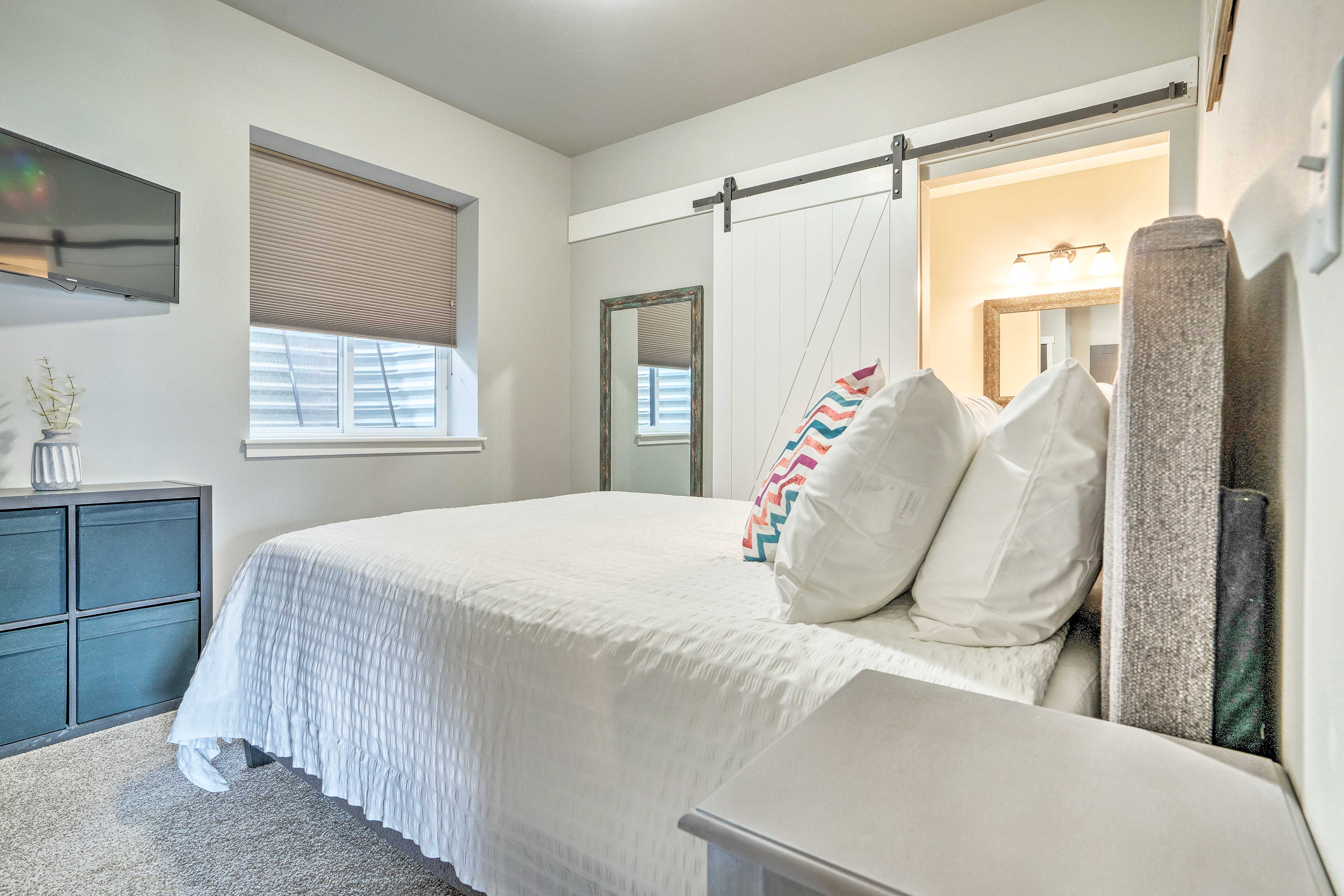 A queen bed and Smart TV highlight the master bedroom.