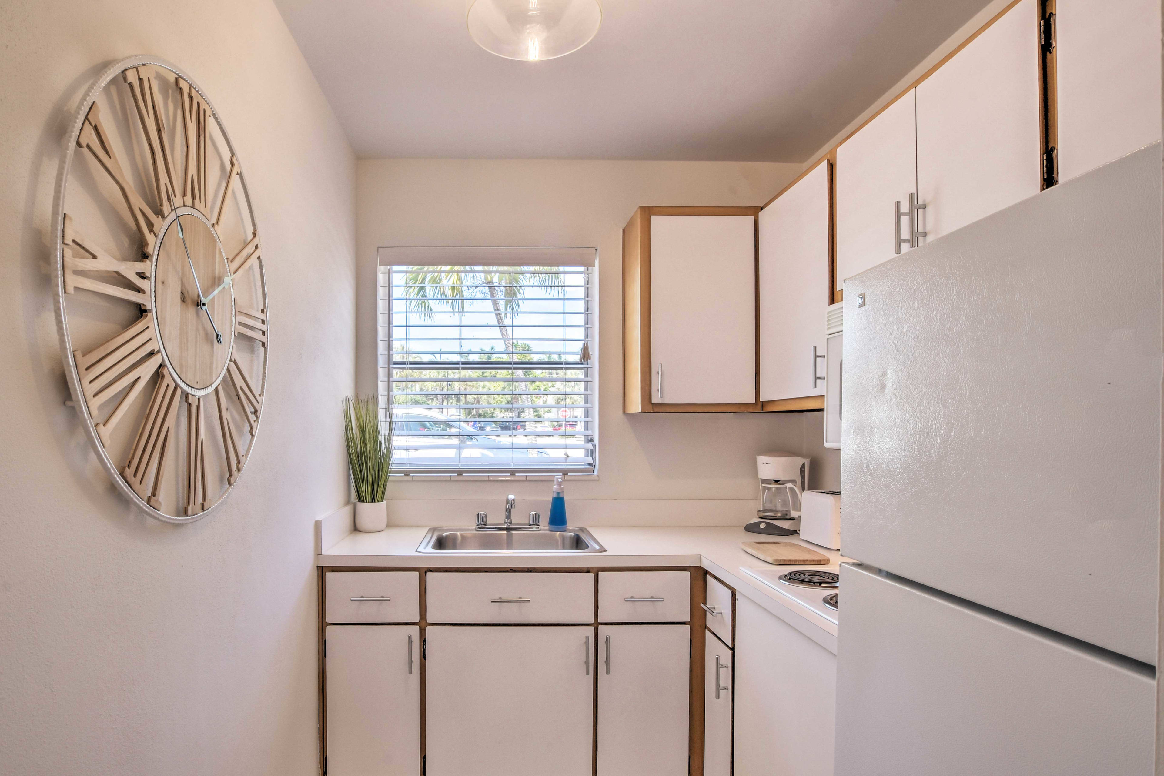 The kitchen comes well equipped with full-sized appliances.