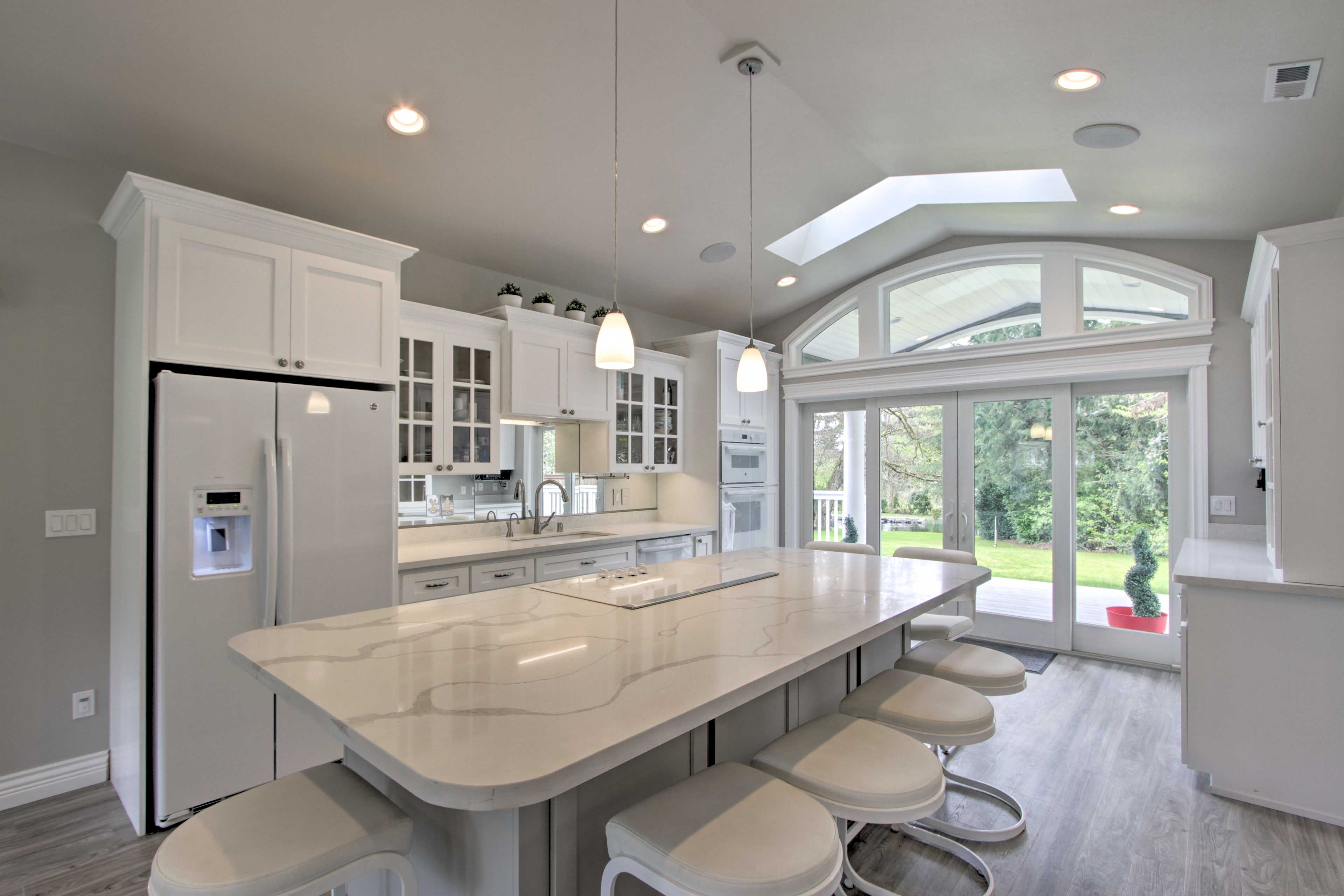 The unit boasts a fully equipped kitchen and plenty of natural sunlight.