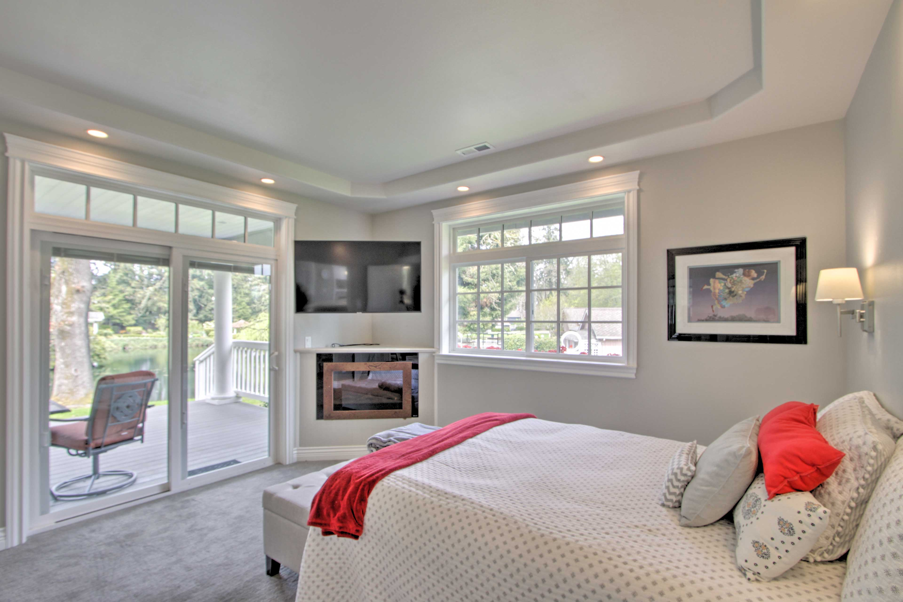 The master bedroom features an electric fireplace.