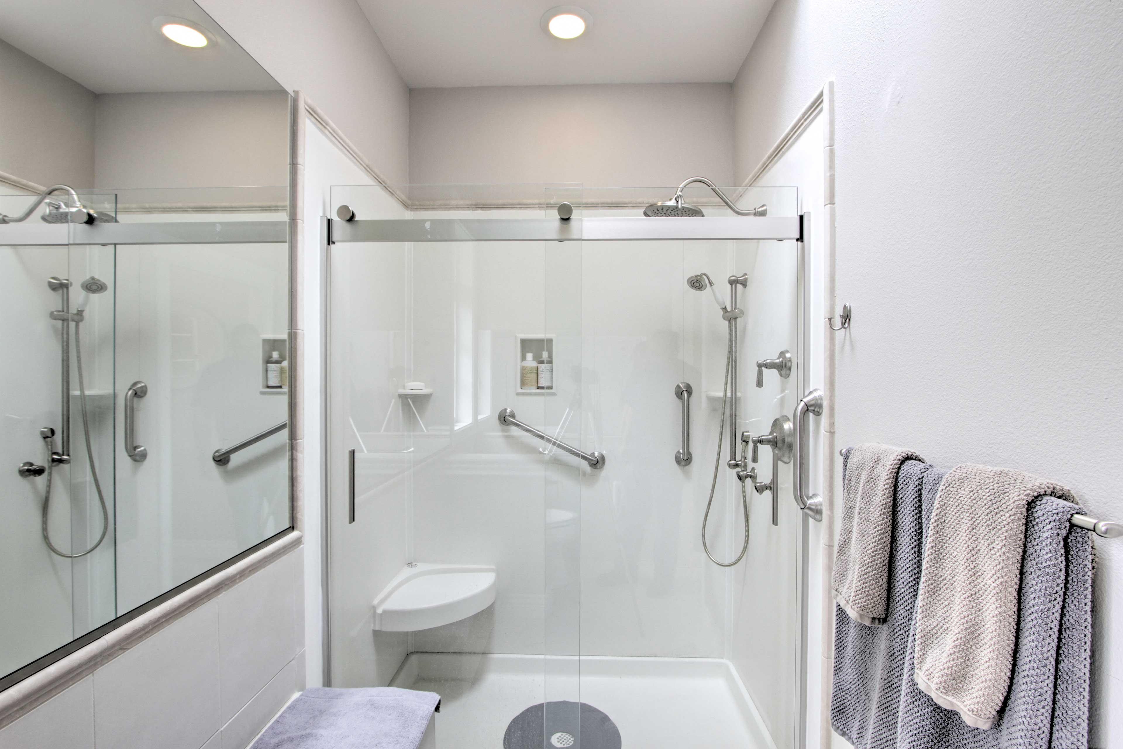 Both showers have grab rails for safety.