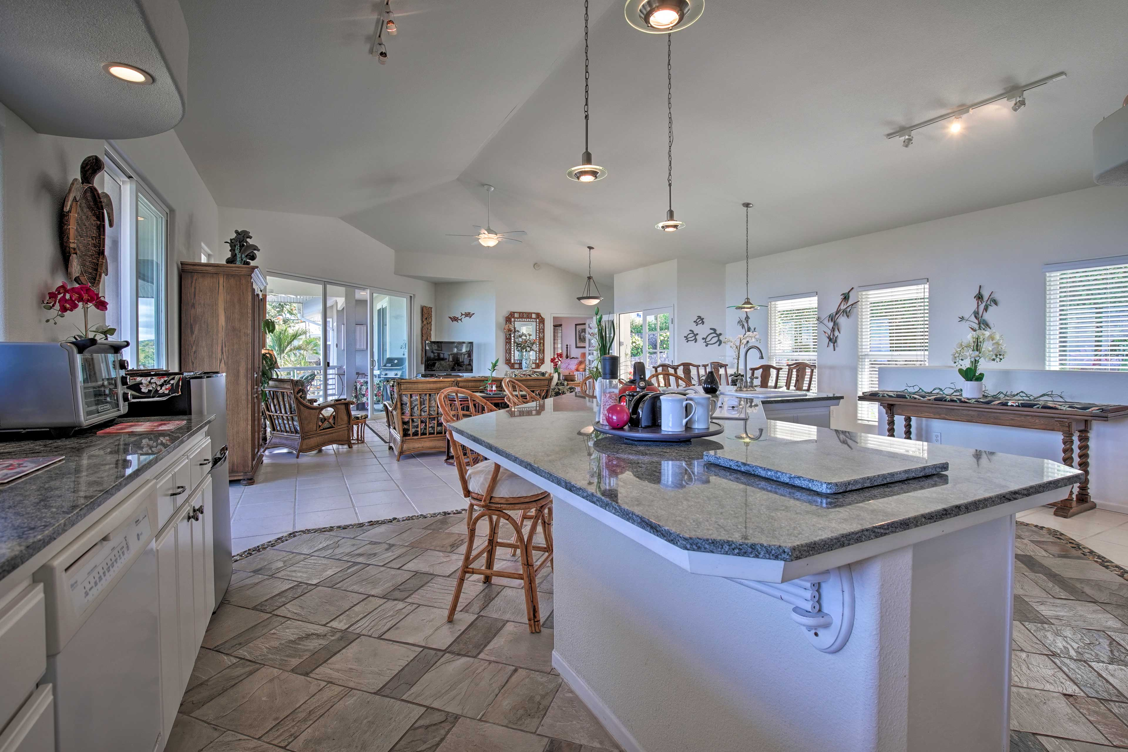 The chef can keep an eye on the whole group with this open-concept living space.