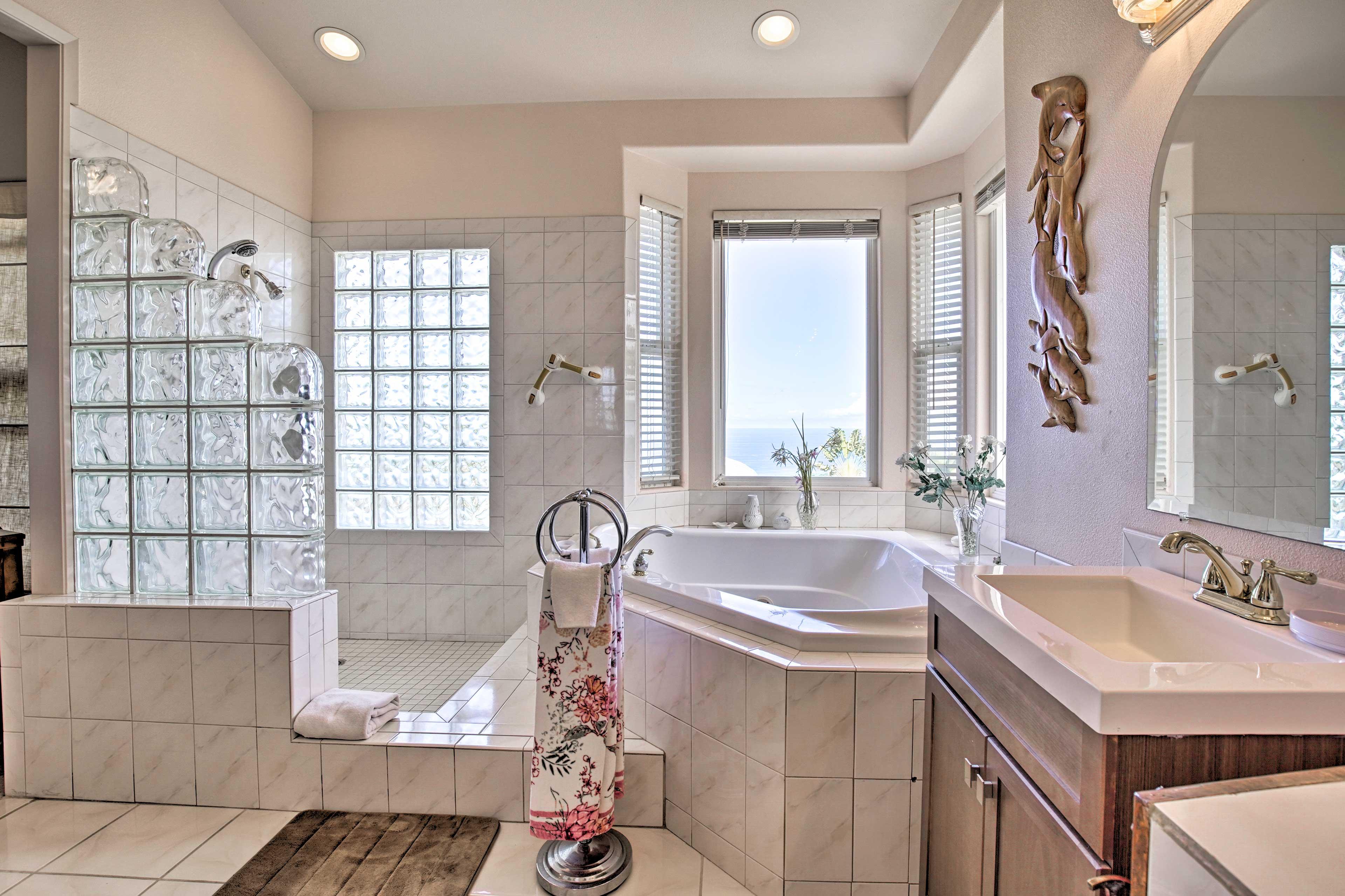 The sleek en-suite bathroom hosts dual sinks, a jaccuzzi tub & walk-in shower.
