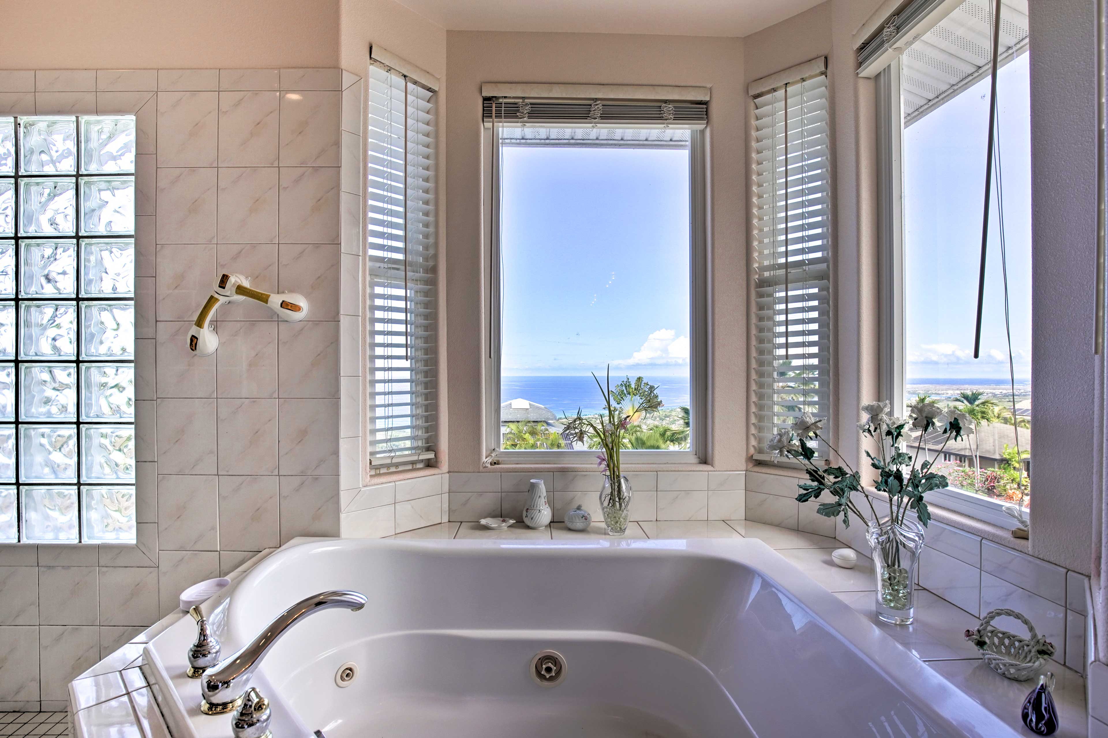 Unwind with a bubble bath and sunset views over the water!