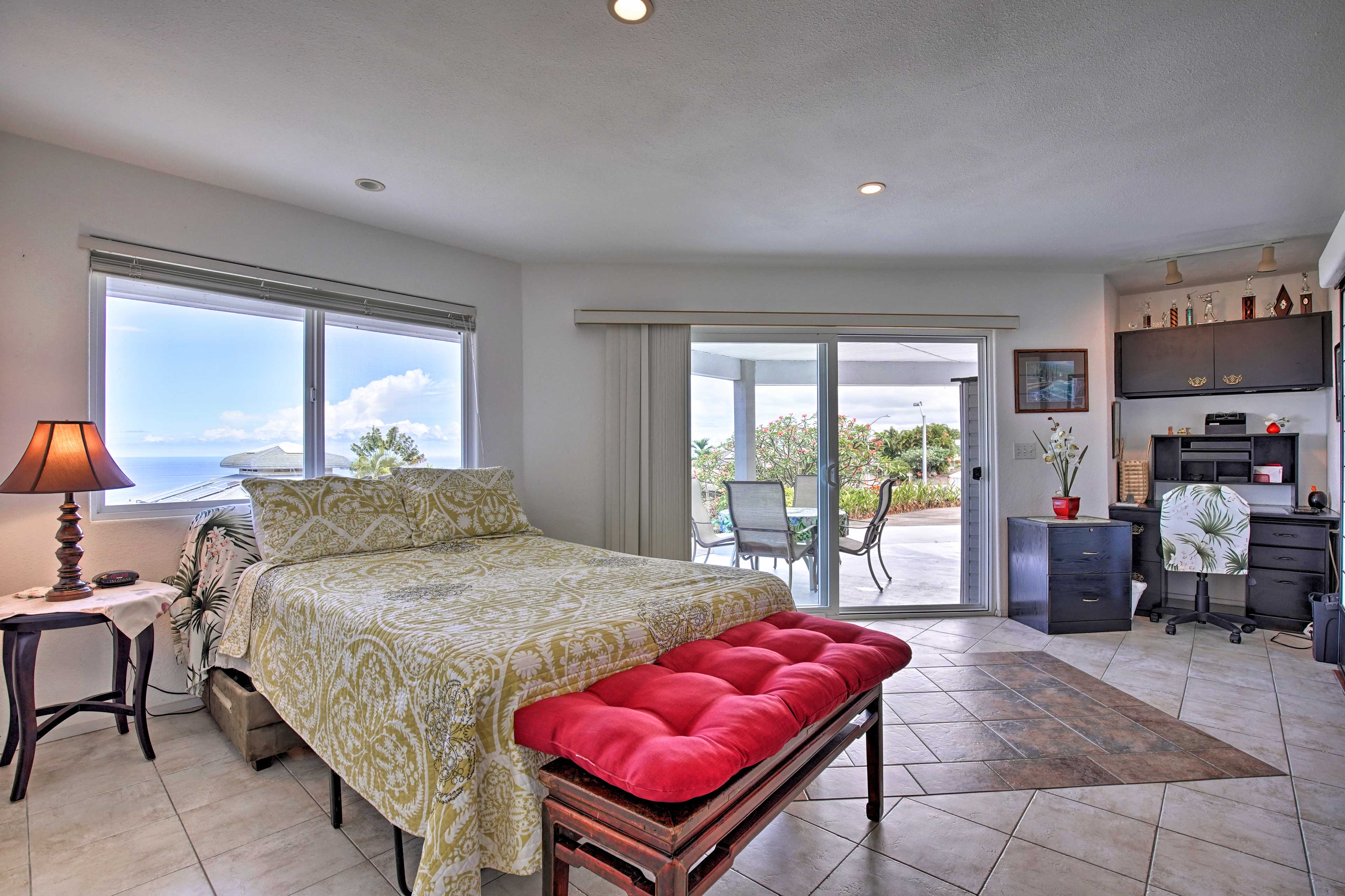 The 'man cave' offers direct access to the spacious lower lanai.