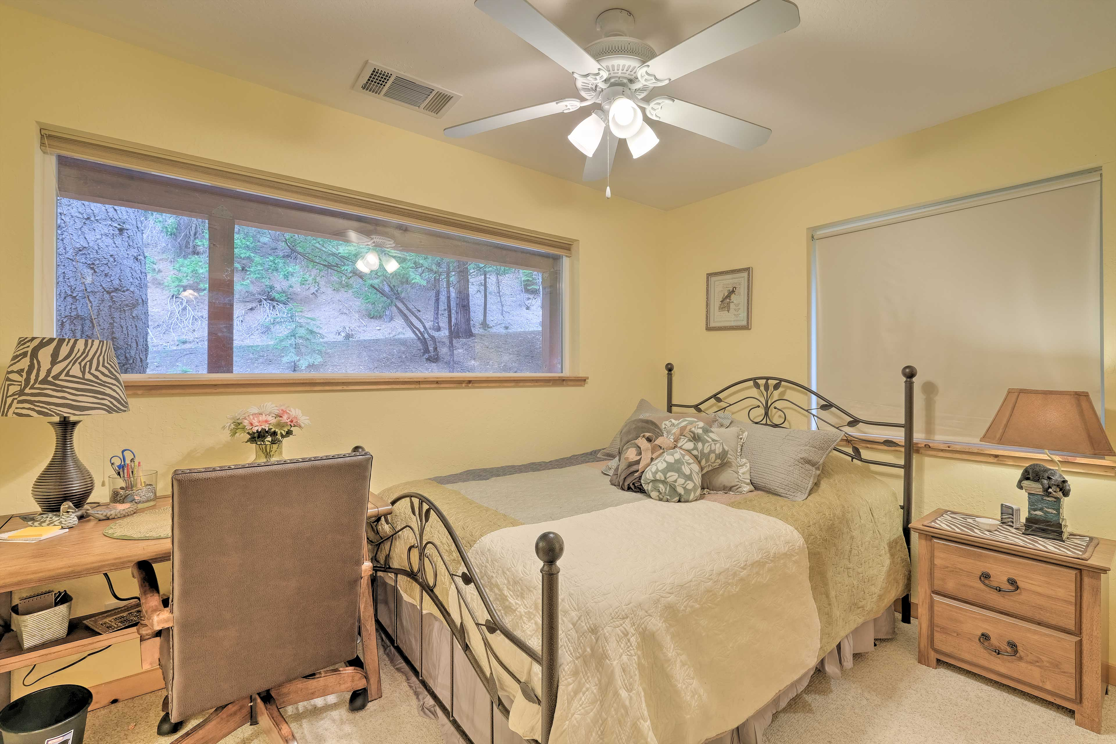 The 3rd bedroom includes a queen bed & laptop-friendly desk.