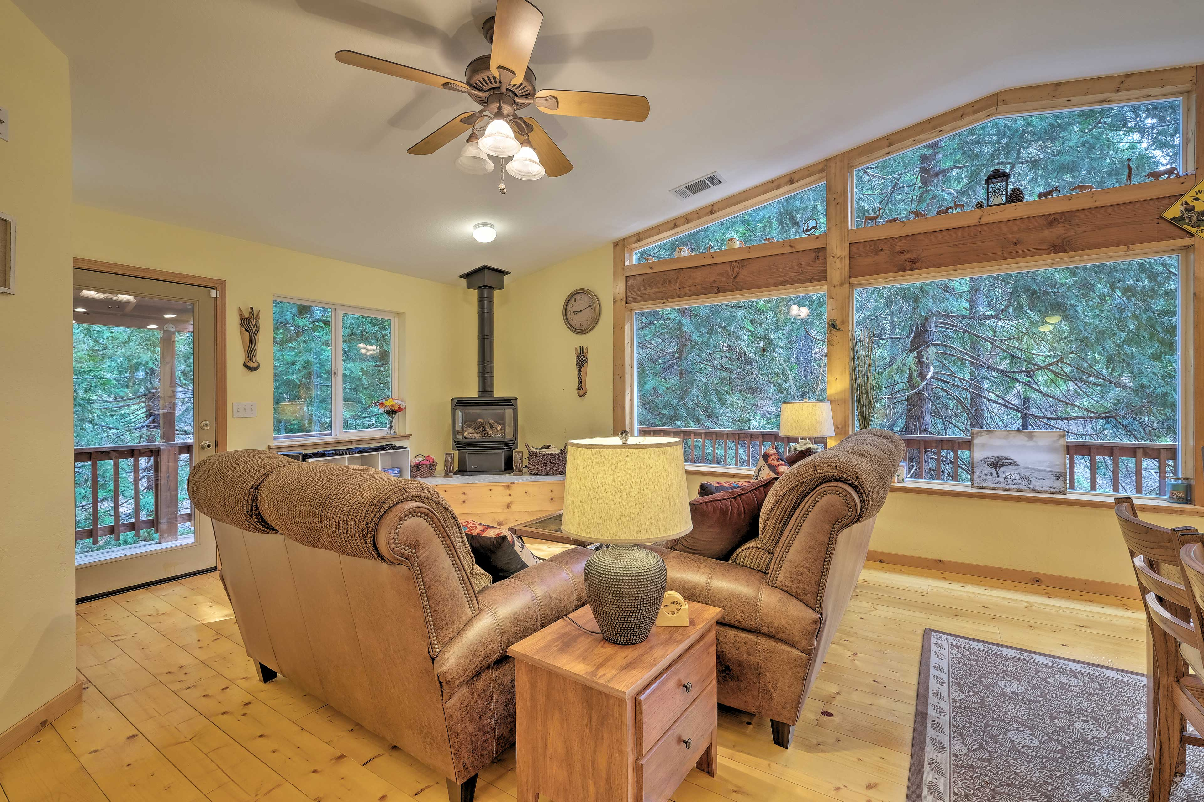 Wide windows frame wooded views.