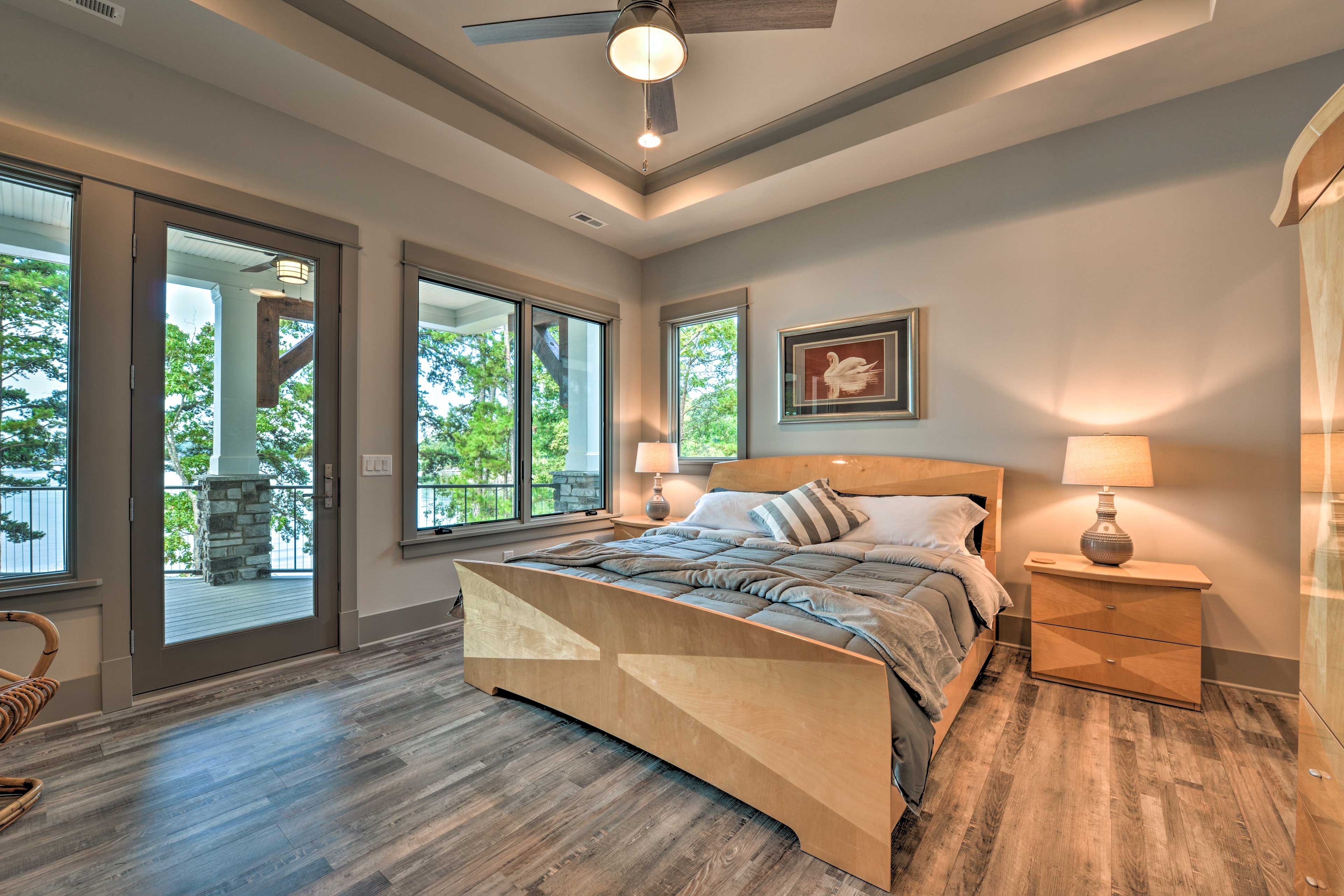 The first master bedroom features a king-sized bed and access to the deck.