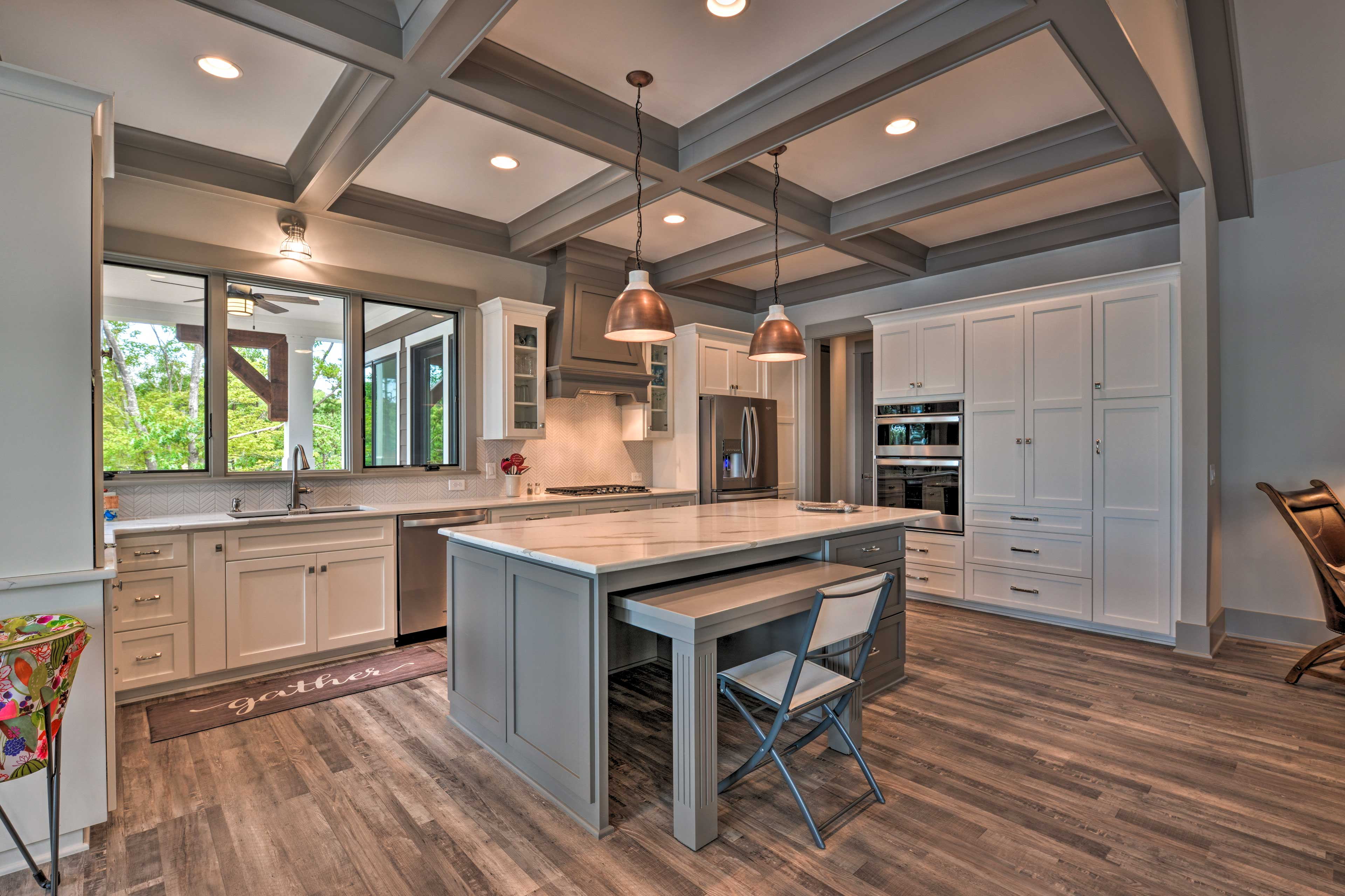 The gourmet kitchen features stainless steel appliances and a large island.