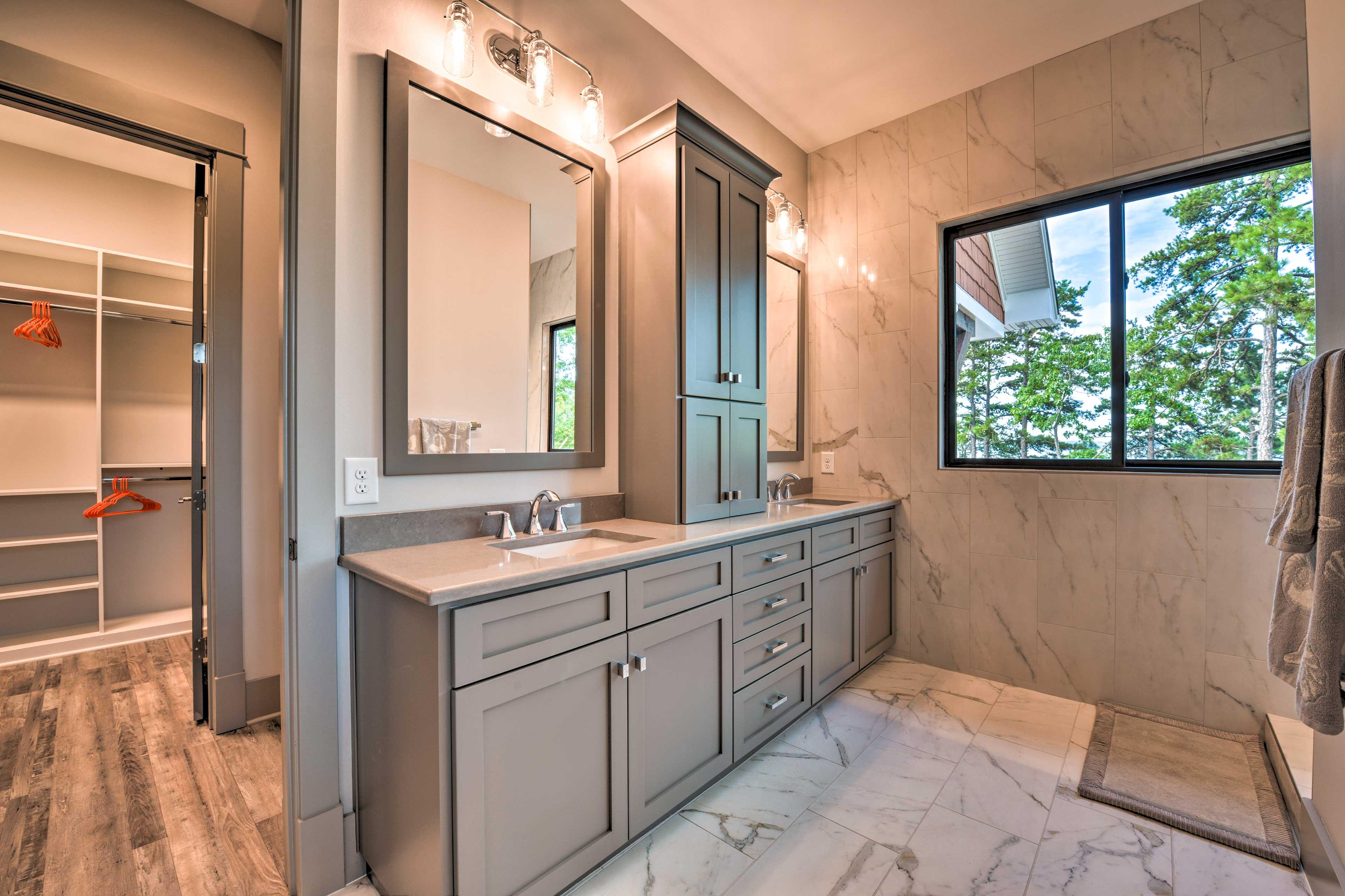 Enjoy the gorgeous en-suite bath with double vanities and a large closet.