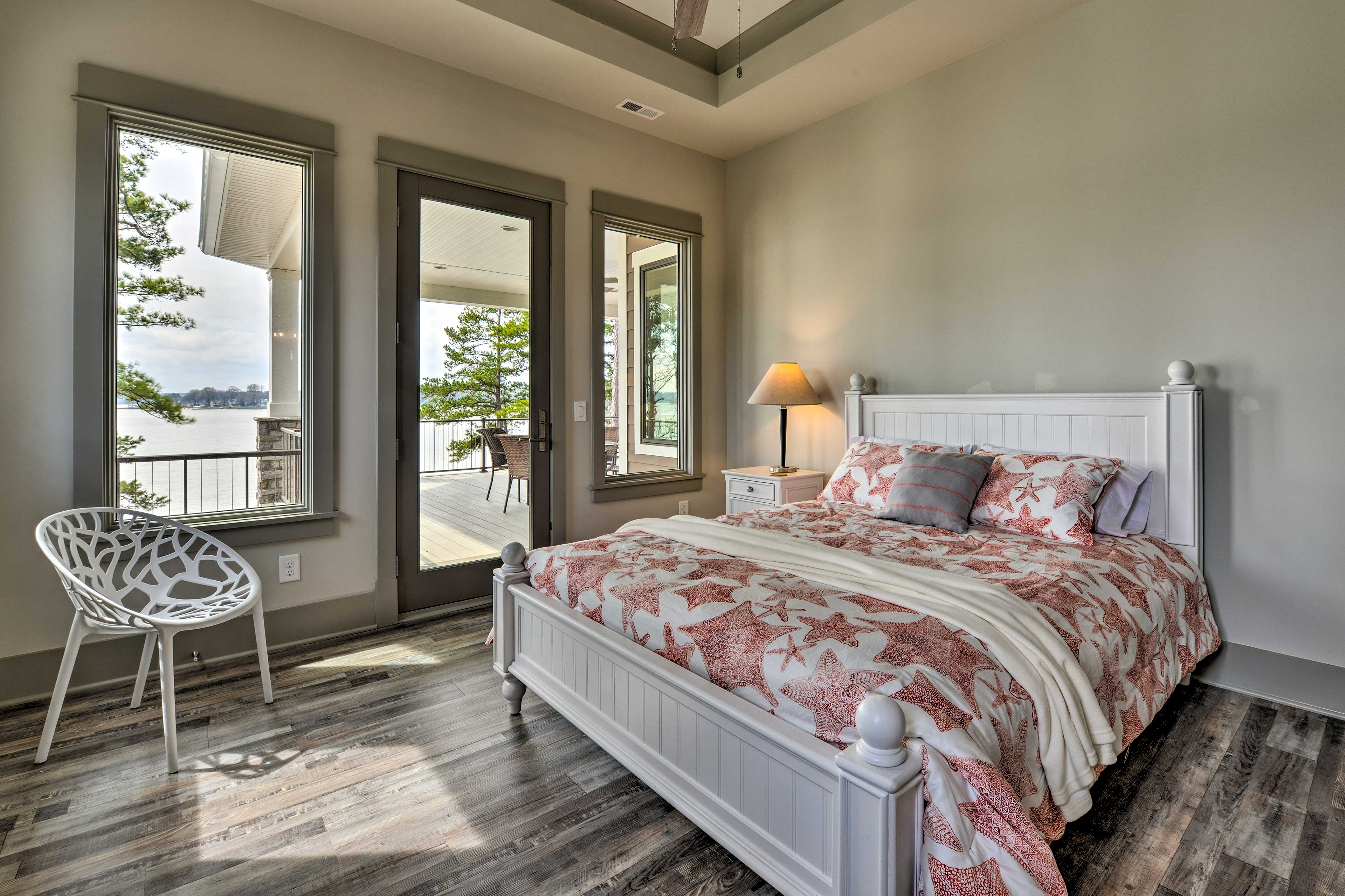 The second master bedroom features a queen-sized bed and access to the deck.