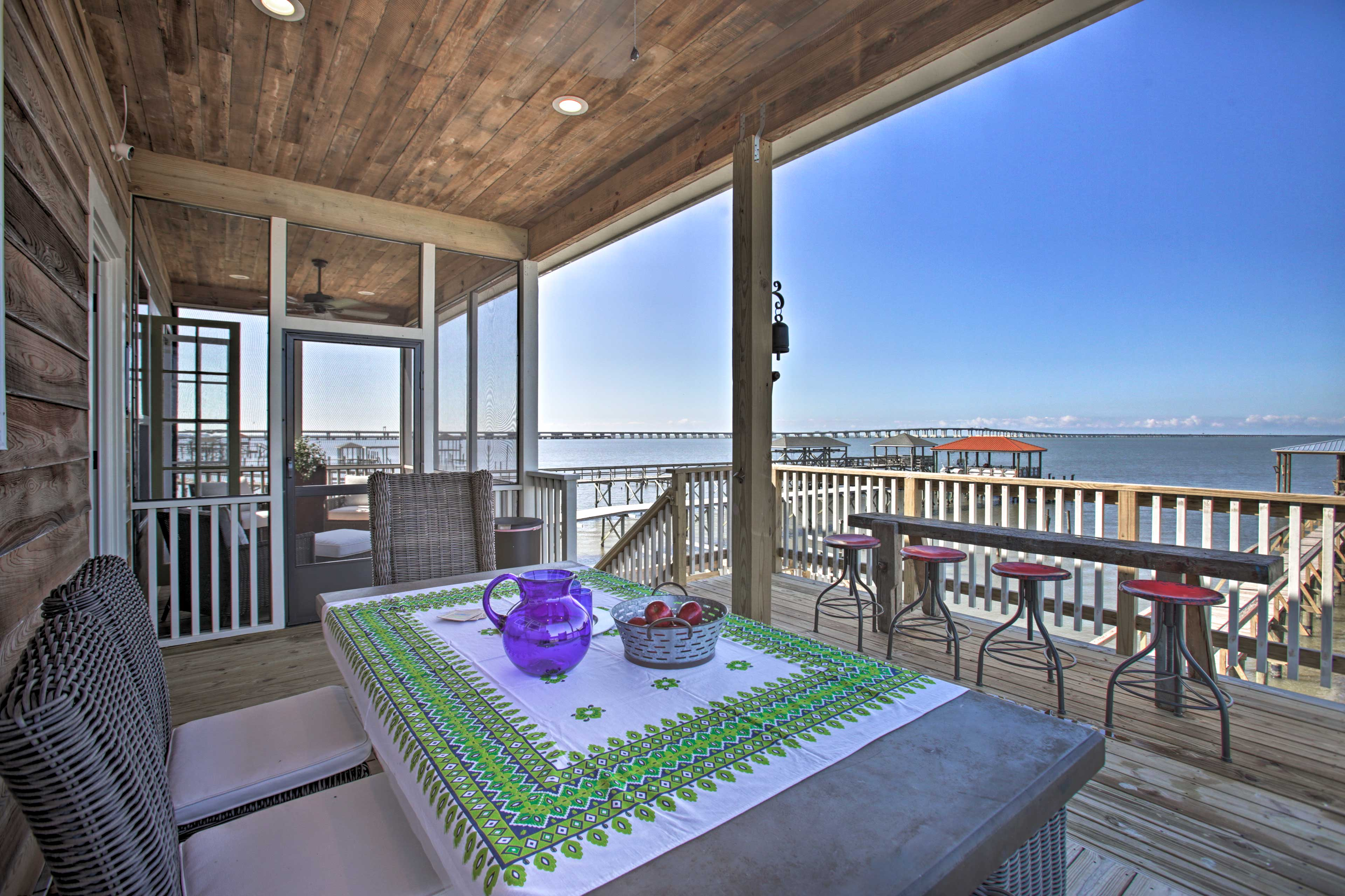 The 3-bedroom, 2-bathroom home boasts a private dock and panoramic views.