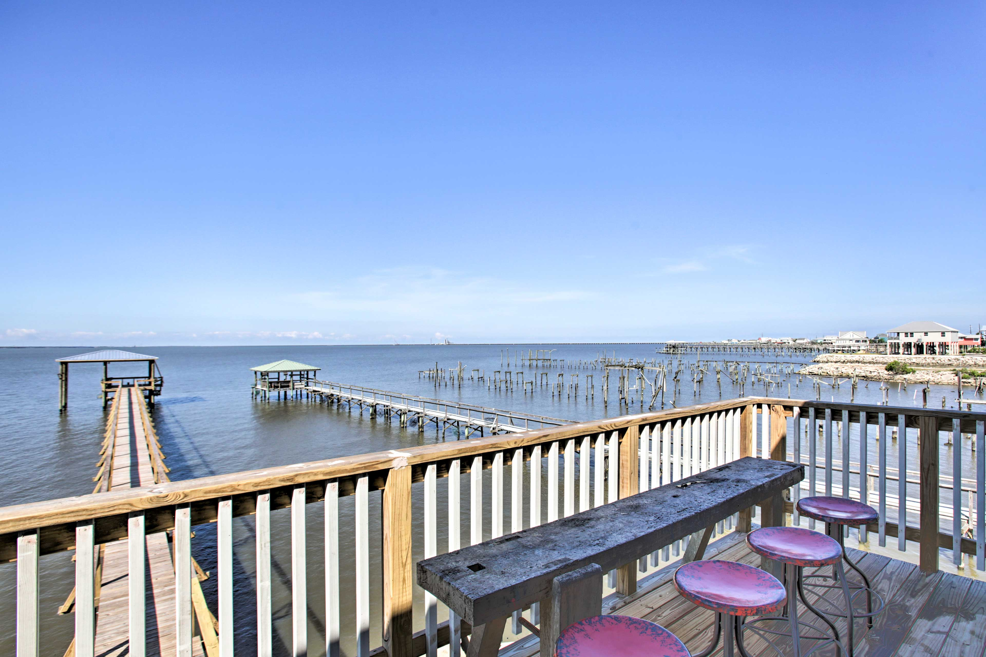 Dine al fresco on the furnished, waterfront deck.