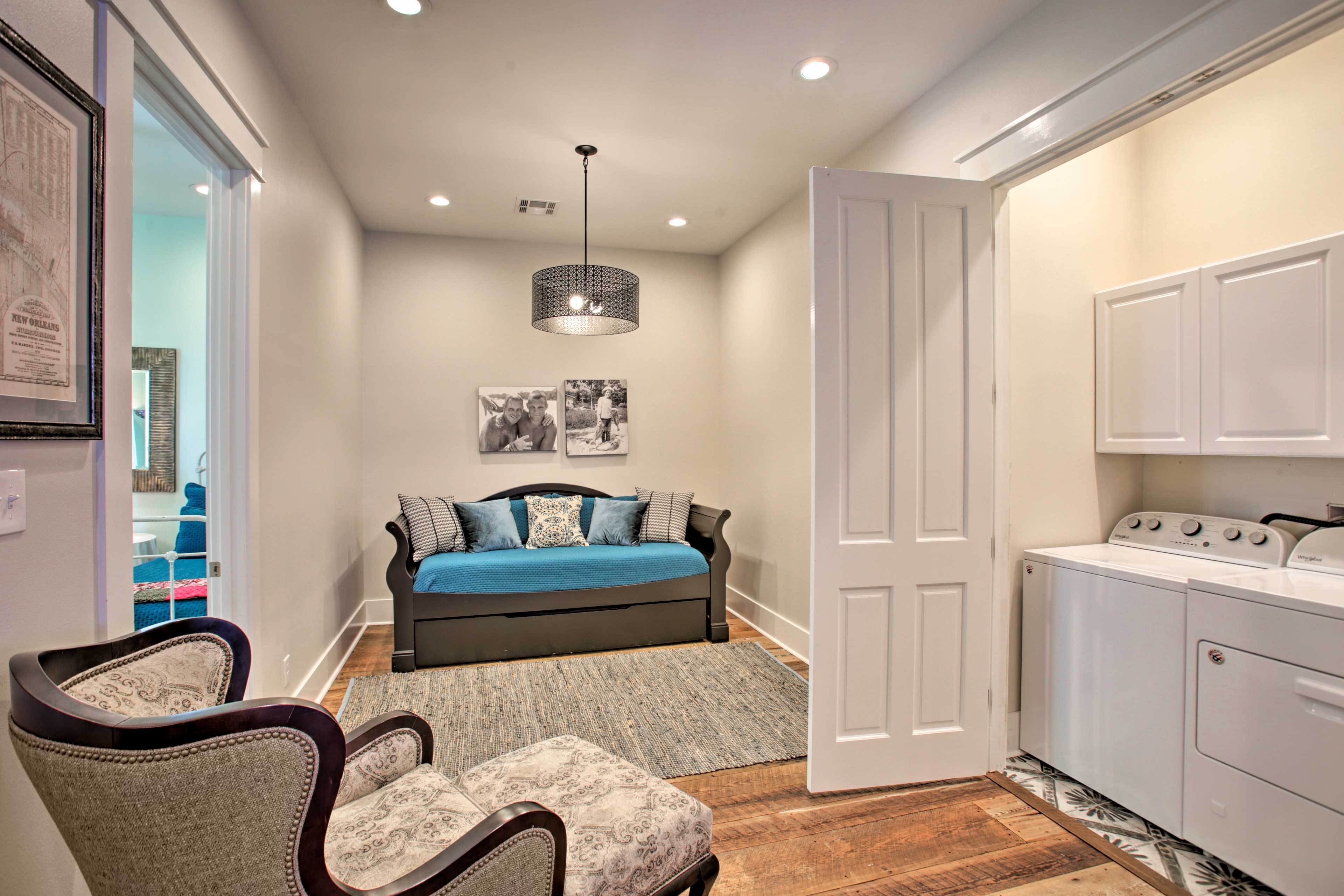 The laundry machines and twin daybed are tucked just around the corner.