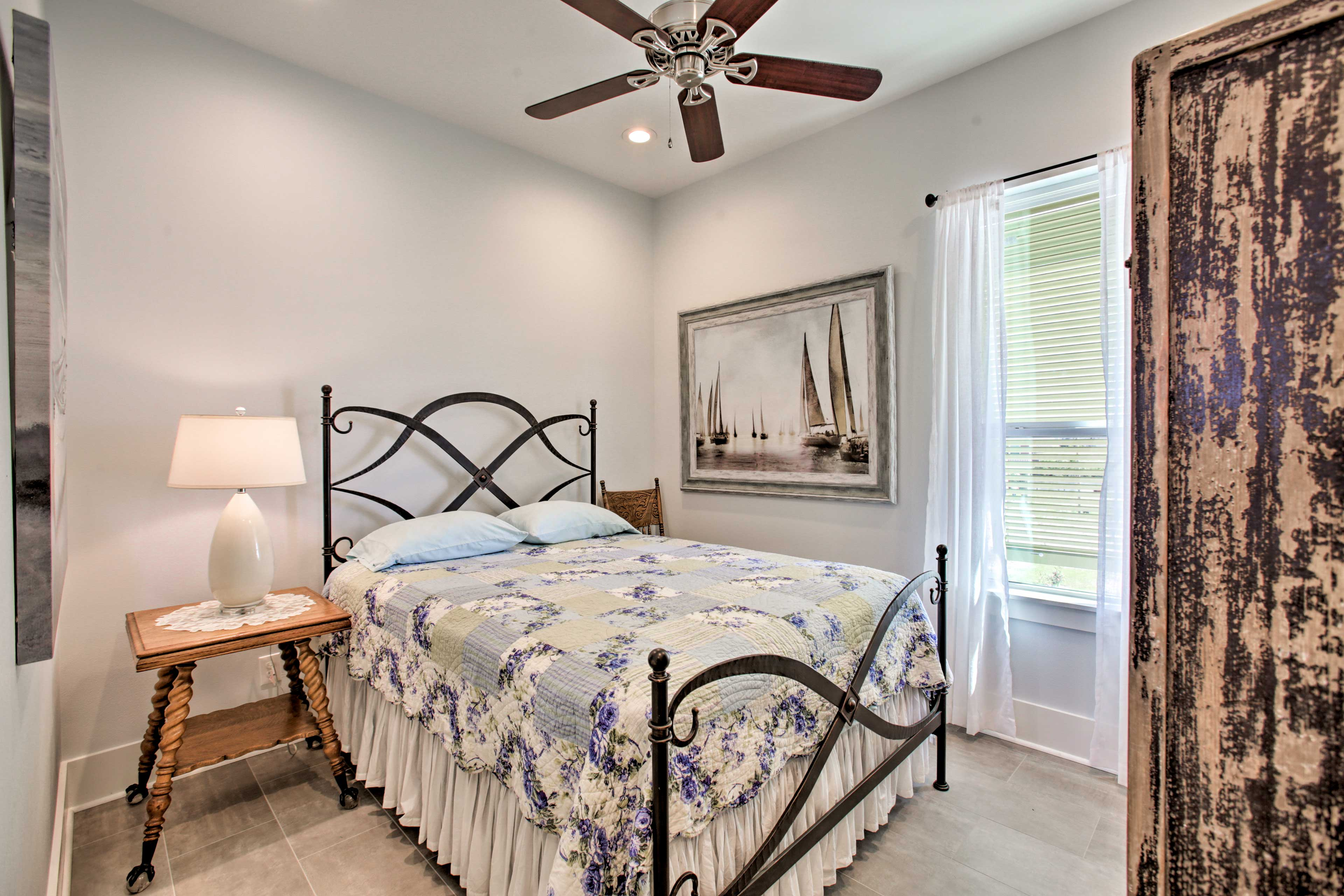 The second bedroom features a queen bed to sleep up to 2 guests.