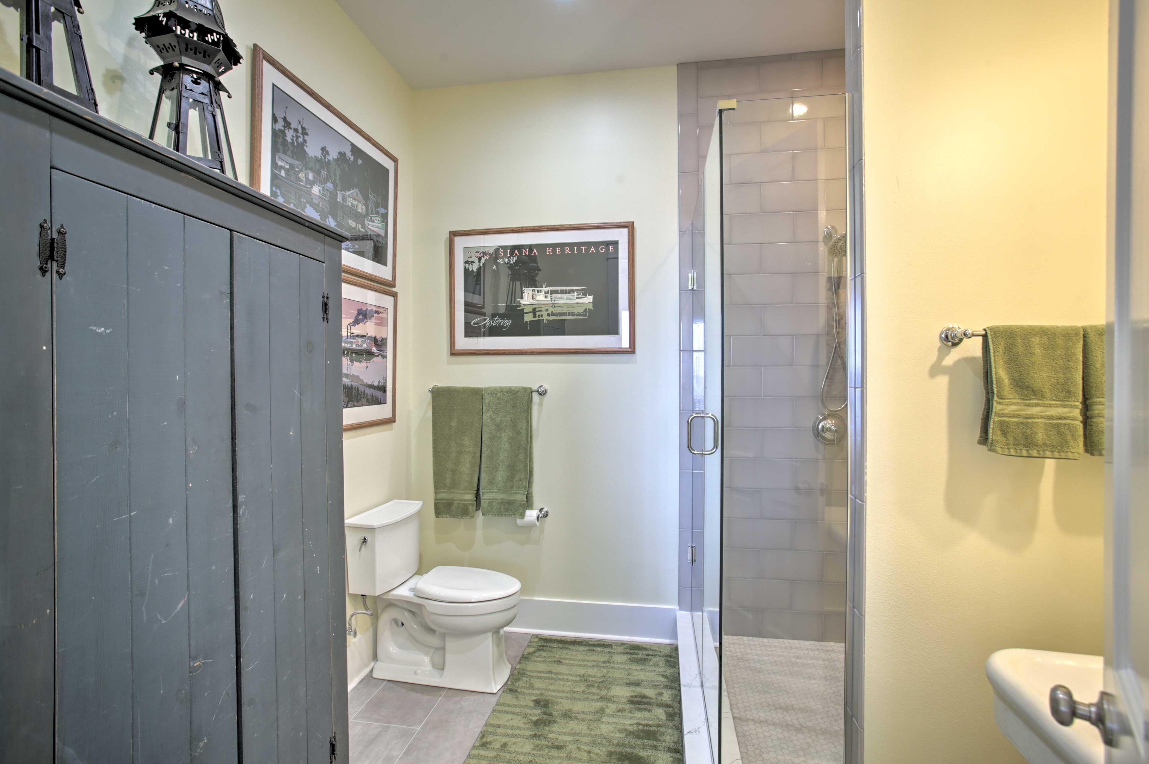 The en-suite bath features a glass-enclosed shower.