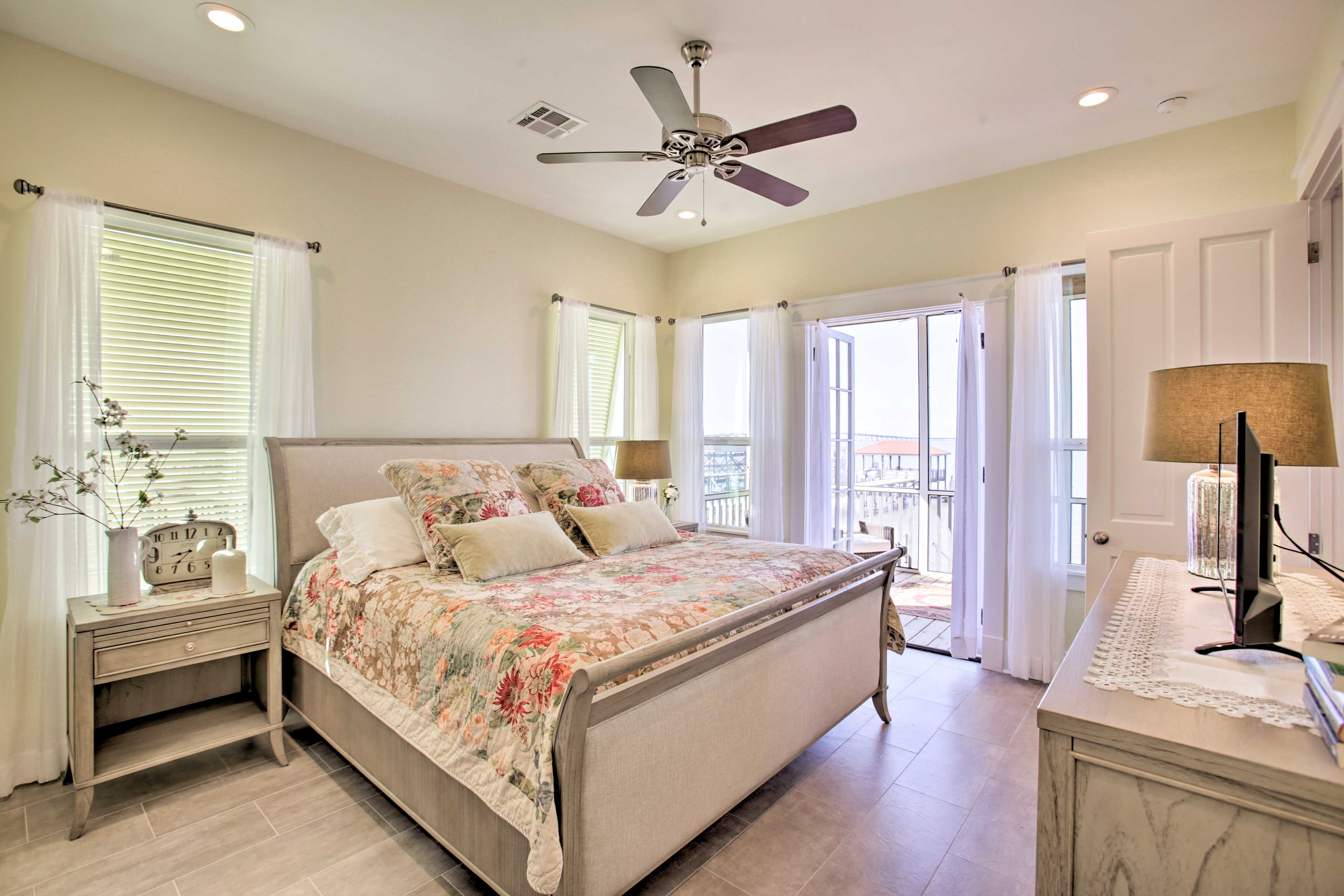 The master bedroom boasts a king bed with direct balcony access.