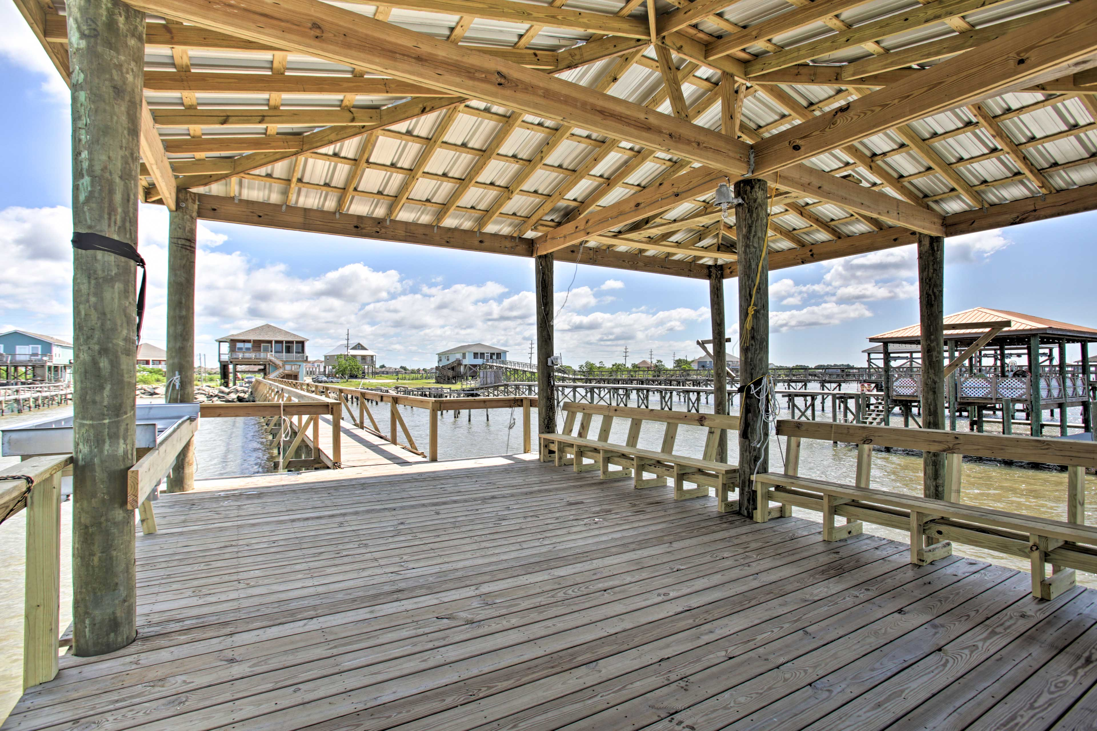 The covered dock is ideal for fishing or cleaning up after a successful outing!