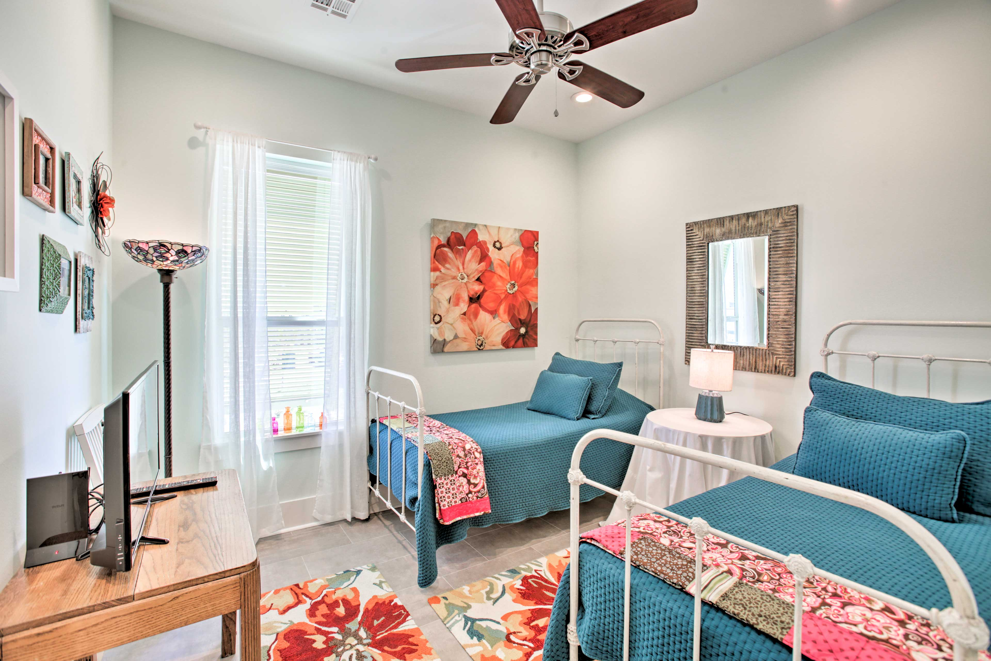 Ideal for kids, this bedroom hosts 2 twin beds and a flat-screen Smart TV.
