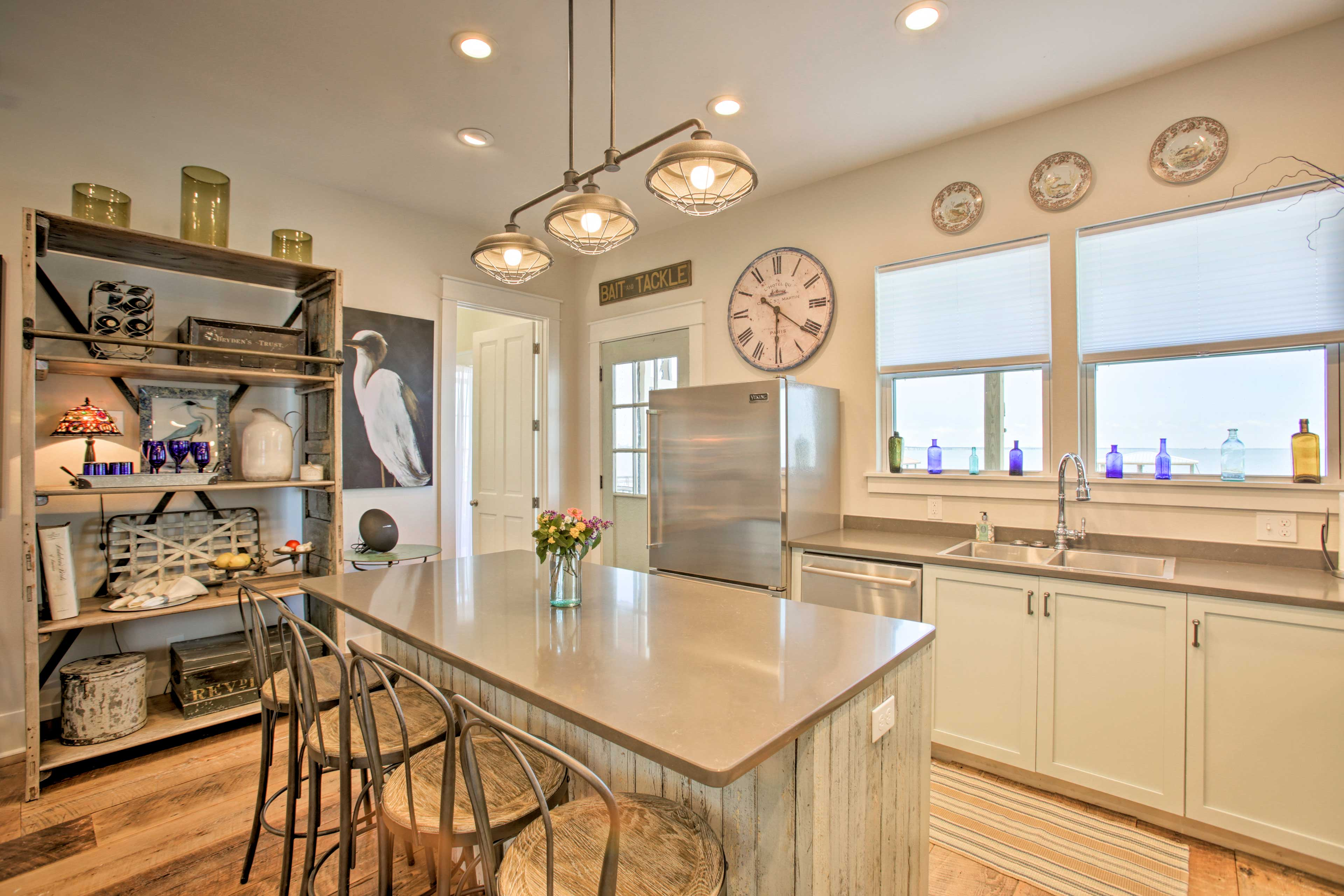 The open layout boasts hardwood floors accented by chic decor.