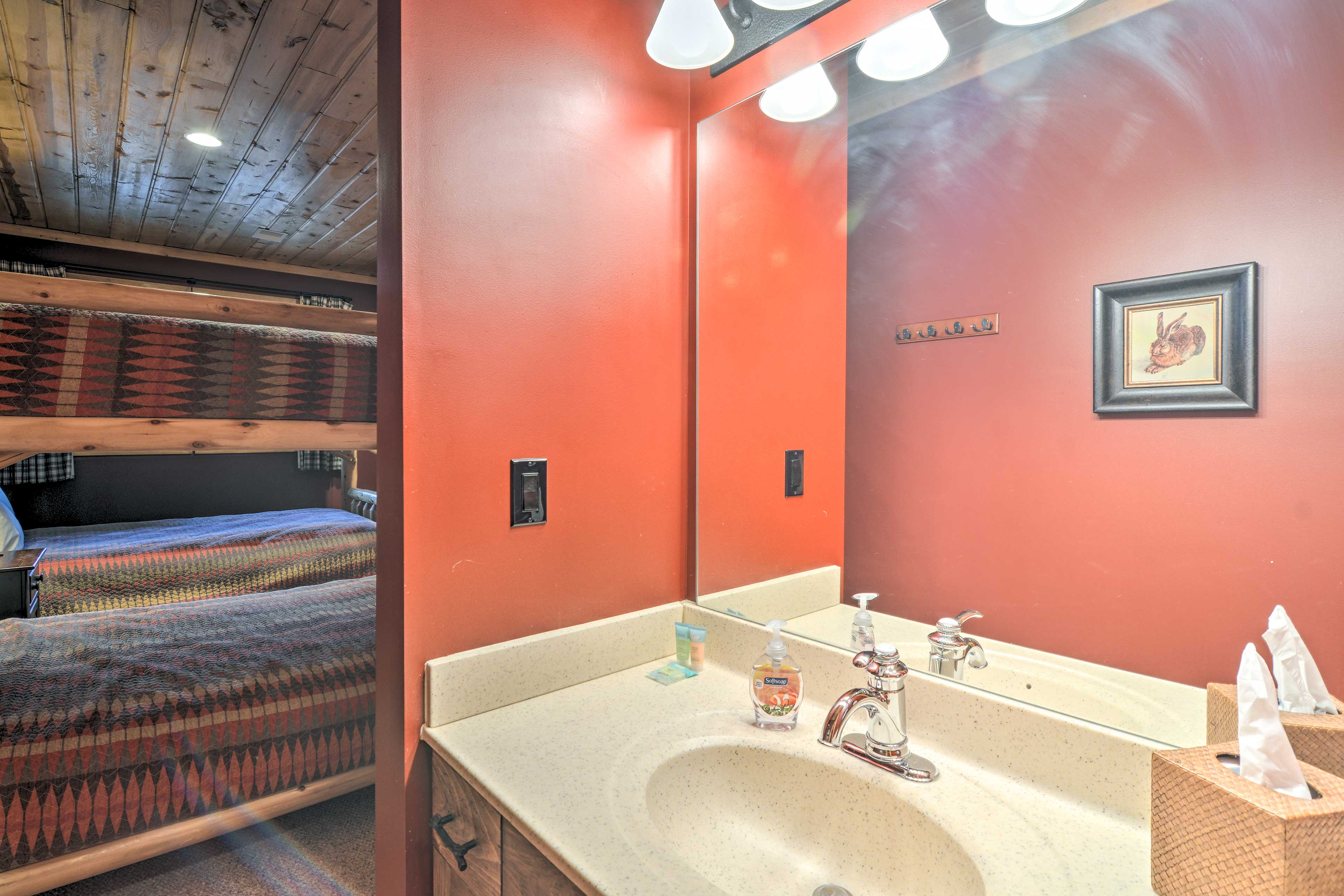 The bunk room has an attached bathroom for extra convenience.