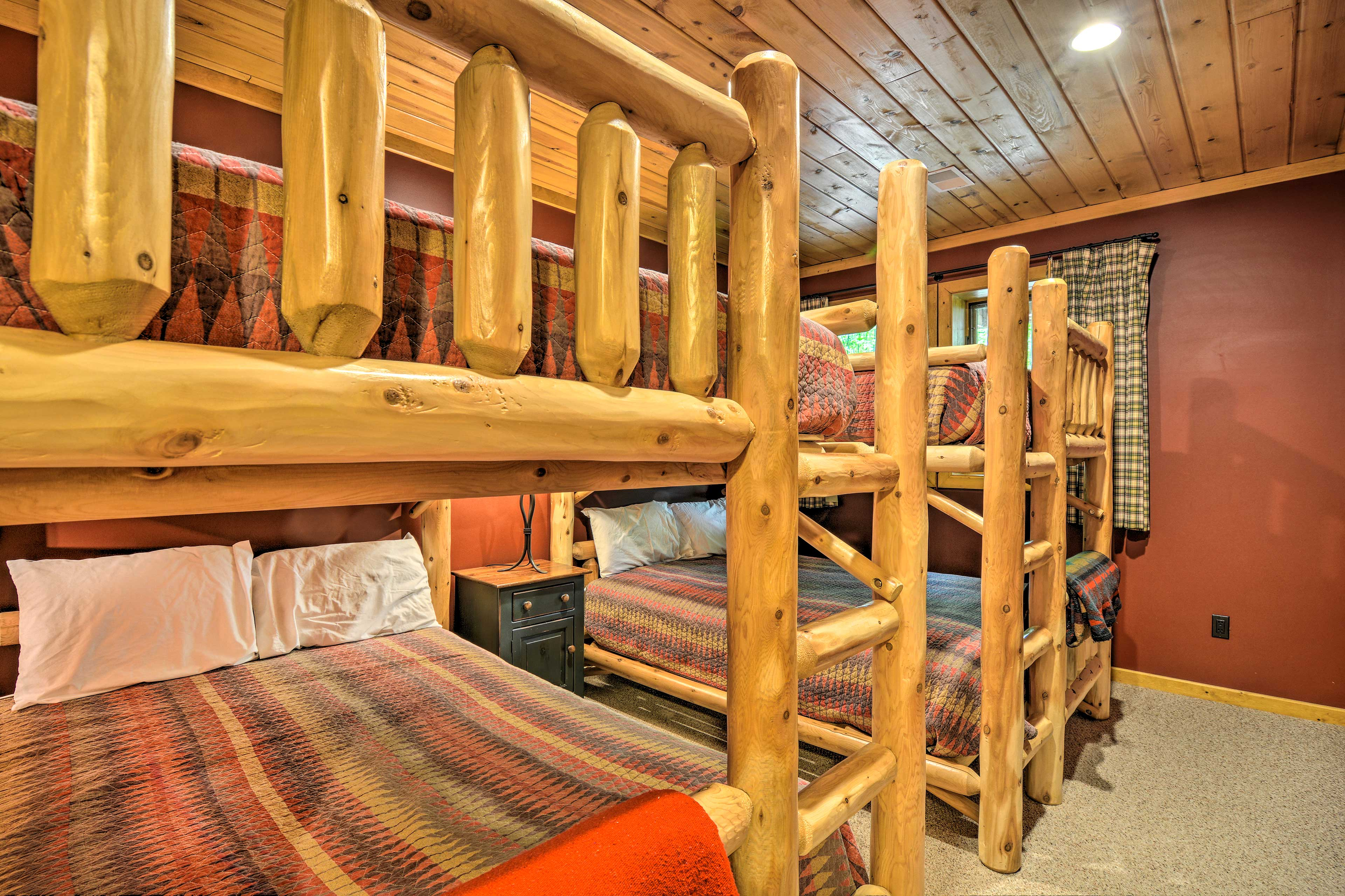 With 2 queen-sized bunk beds, this room can sleep 8.