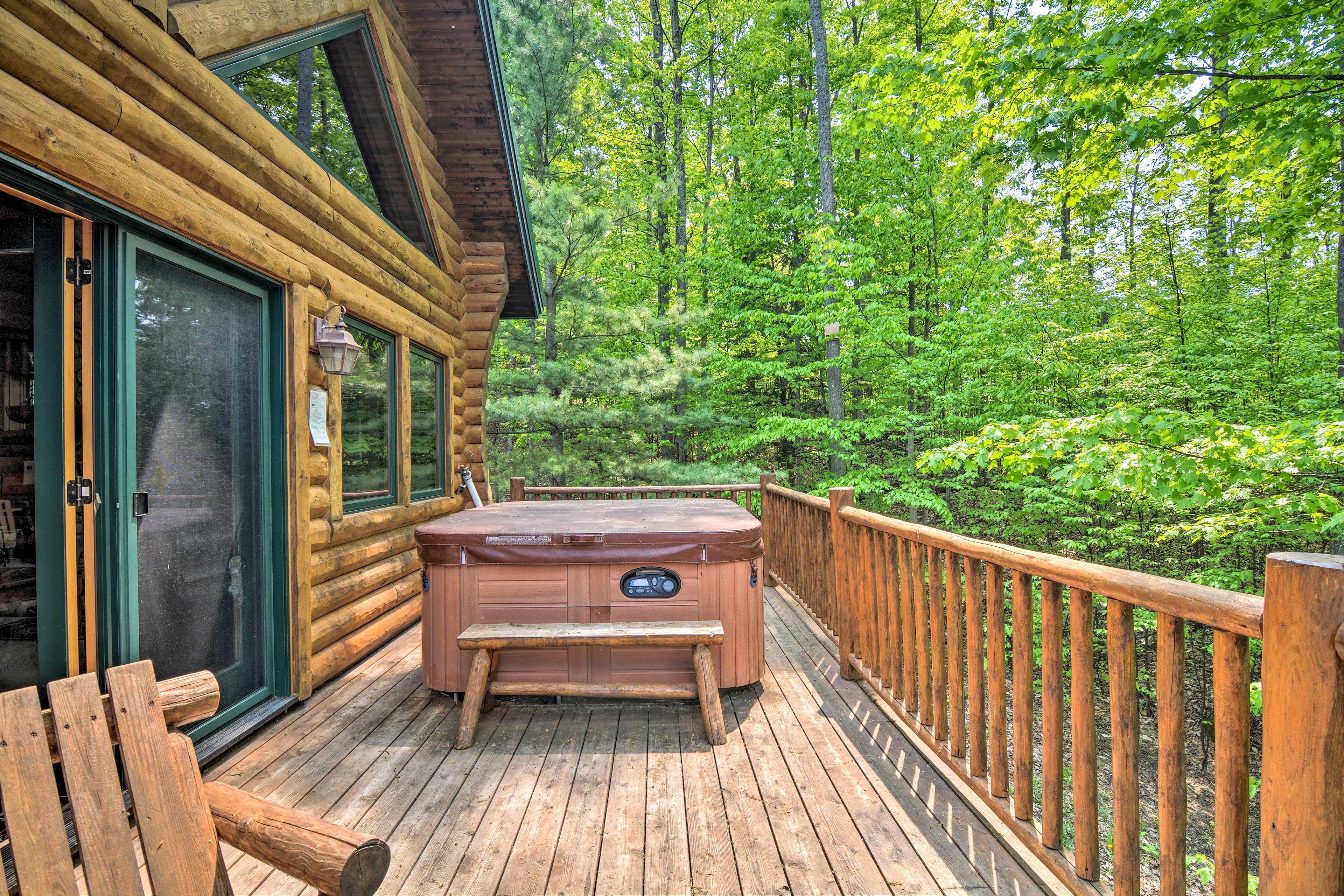 Soak sore muscles from skiing in the private hot tub.
